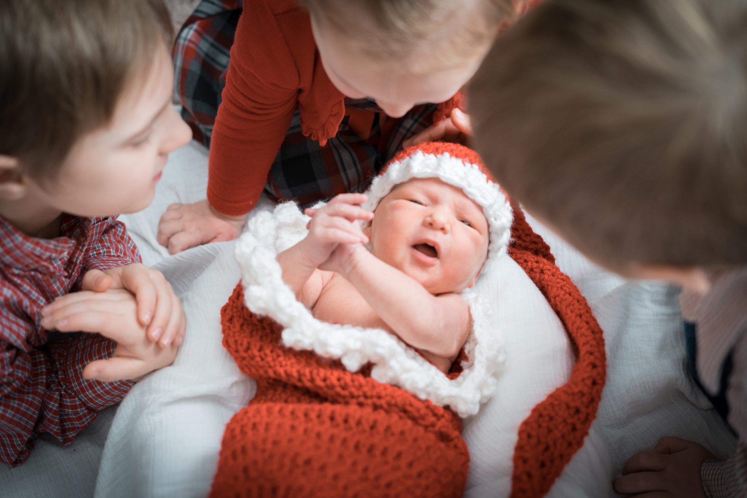 Kids around newborn