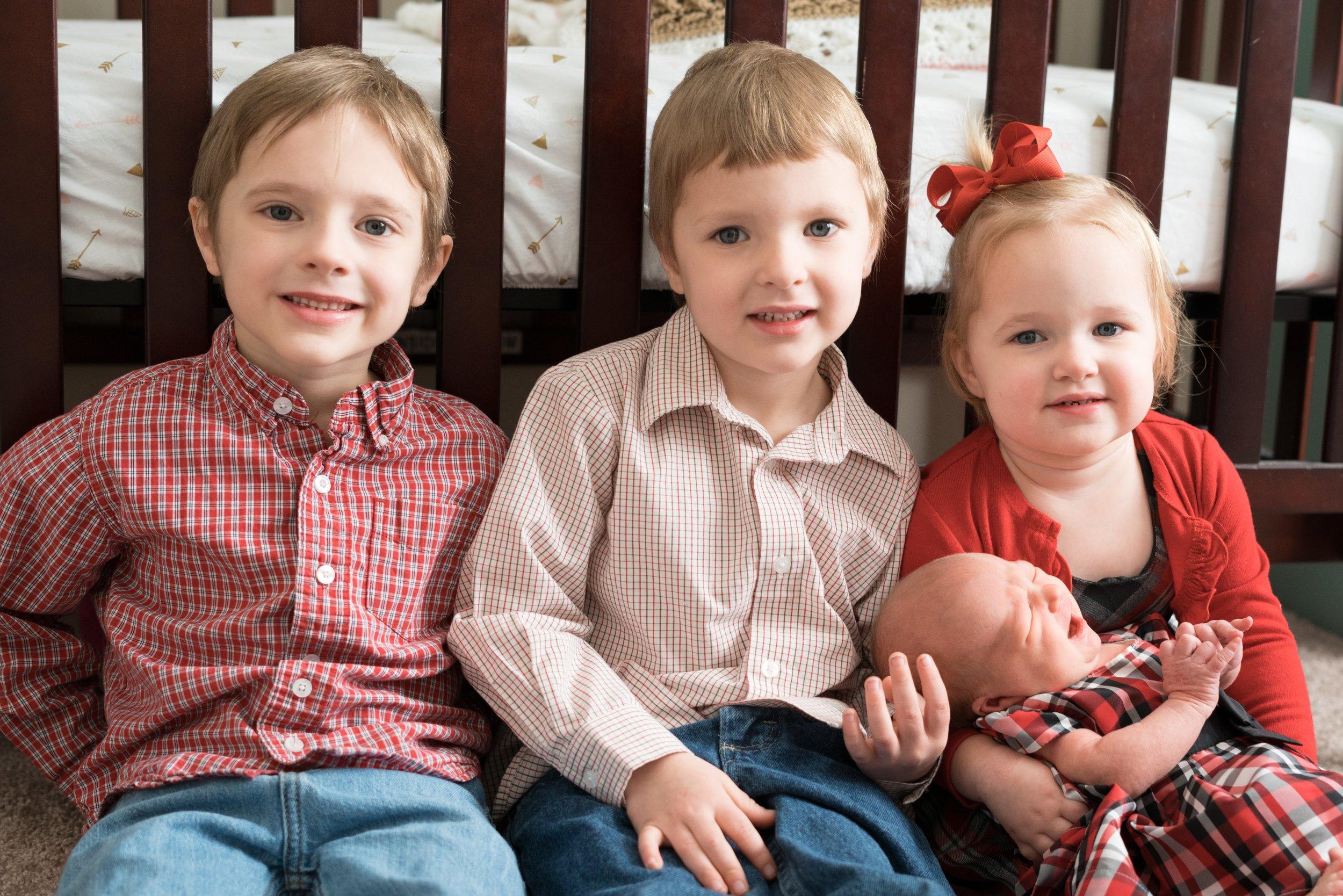Baby girl and siblings