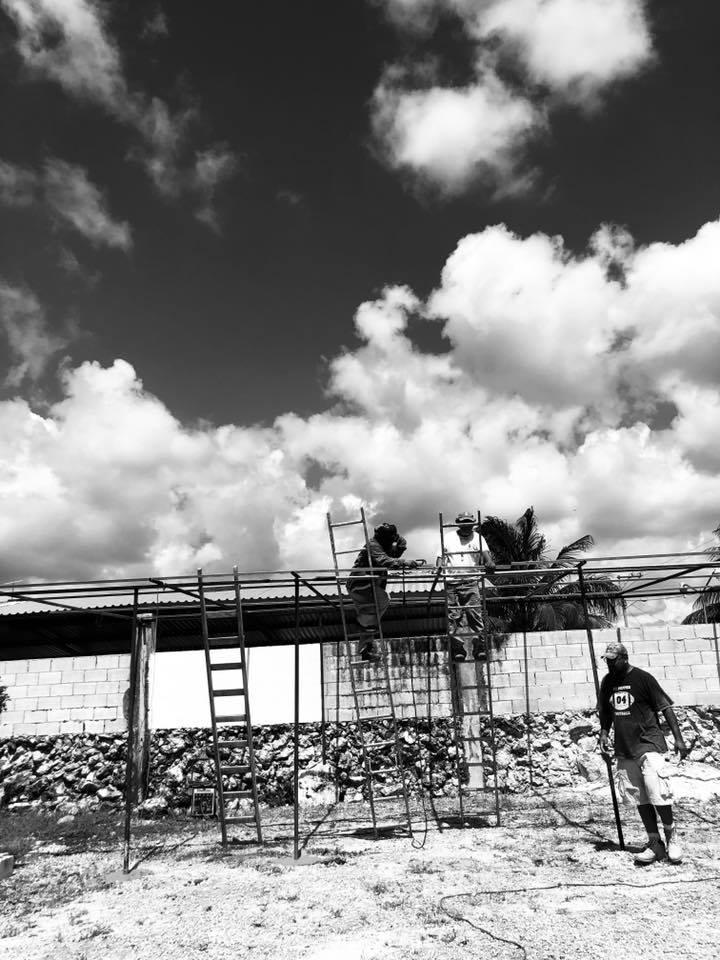Candido and Miriam roof preparation.jpg