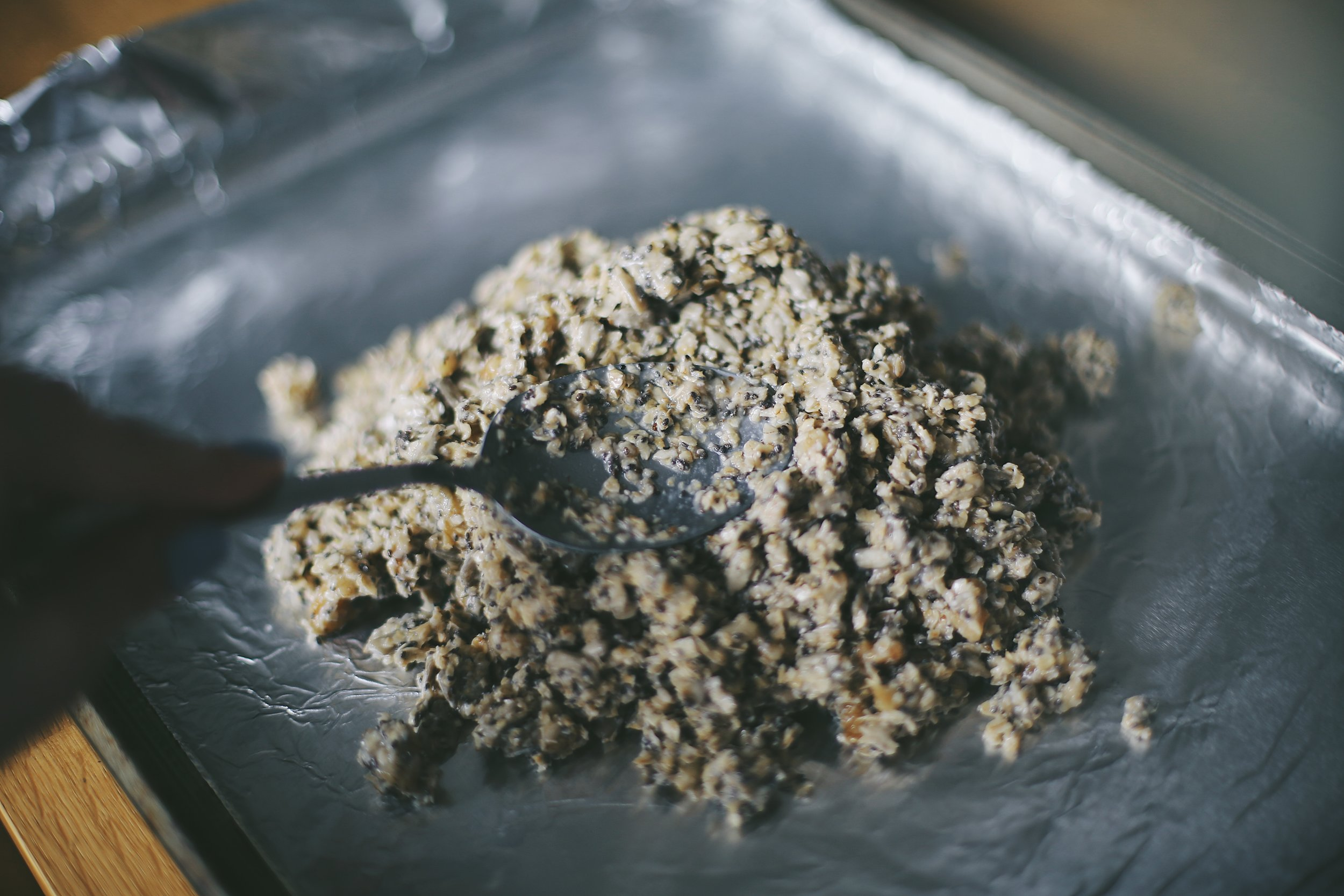 If it looks like MUSHY BIRD FOOD, you'RE DOING it right! - 8. Spread the mixture evenly to the coated parchment paper you have ready because you prepped like a BOSS.