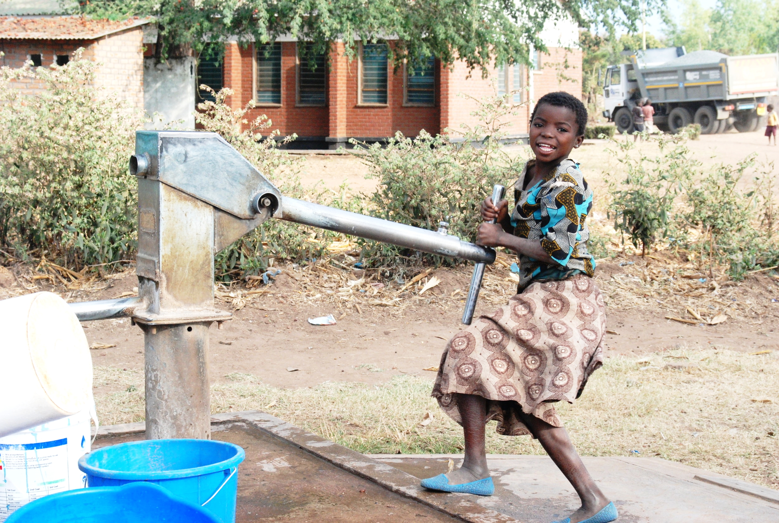 The Akazi Project - Girl at Water Well - www.theakaziproject.org