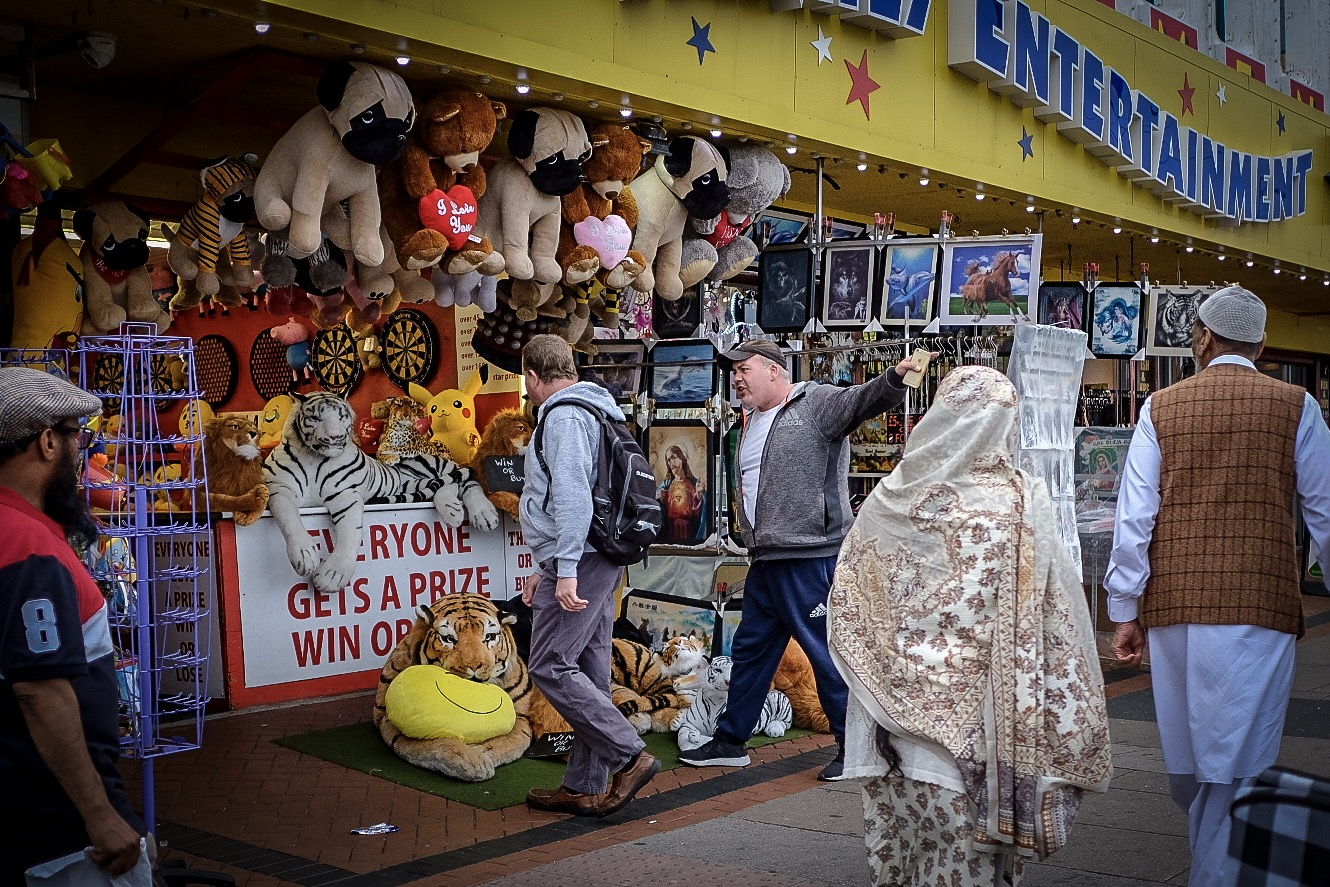 "Immediately before I took this picture that. Guy in the hoody hilariously kicked a giant stuffed tiger into the pictures of Jesus and horses. He was screaming something along the lines of ""My son isn't even here!"""