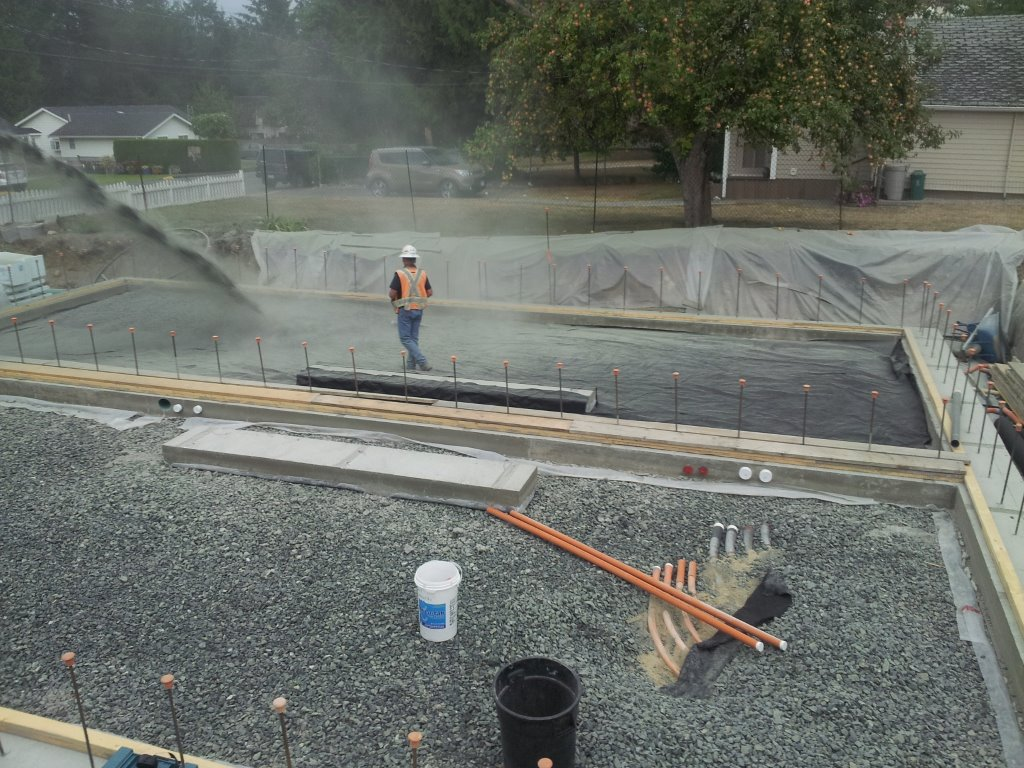 Once our perfectly level footings are poured we then add another 10 inches of drain rock.