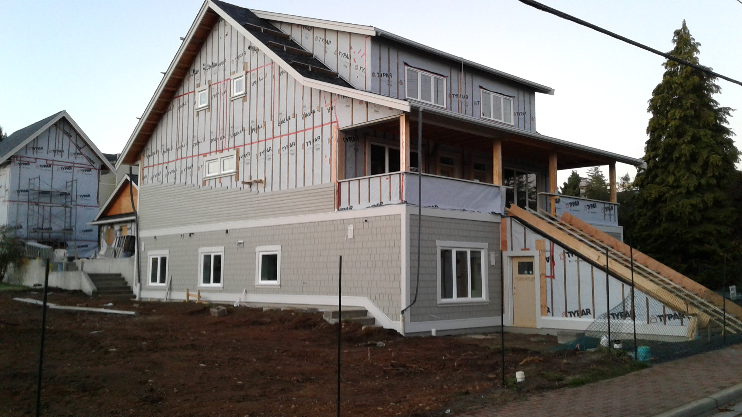Rosemary Manor now starting to look like the lovely Gal she is. James Hardie Artisan Siding and Shingles are being attached here.
