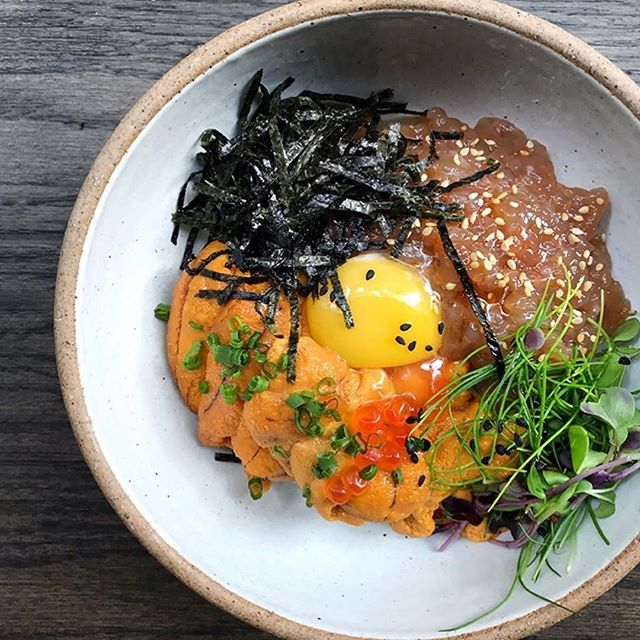 #FoodFact: Dup Bap is a Korean dish made up of rice with cubed raw seafood, and various veggies. Grab a spoon and mix well for a burst of savory flavors!  Living in NYC? Try Samwon Garden Korean BBQ's Uni Dup Bap. Sea urchin (uni) and shrimp topped with an egg yolk, ikura (fish roe), seaweed and fresh microgreens on a bed of rice.  Photo by: @samwongardenbbq
