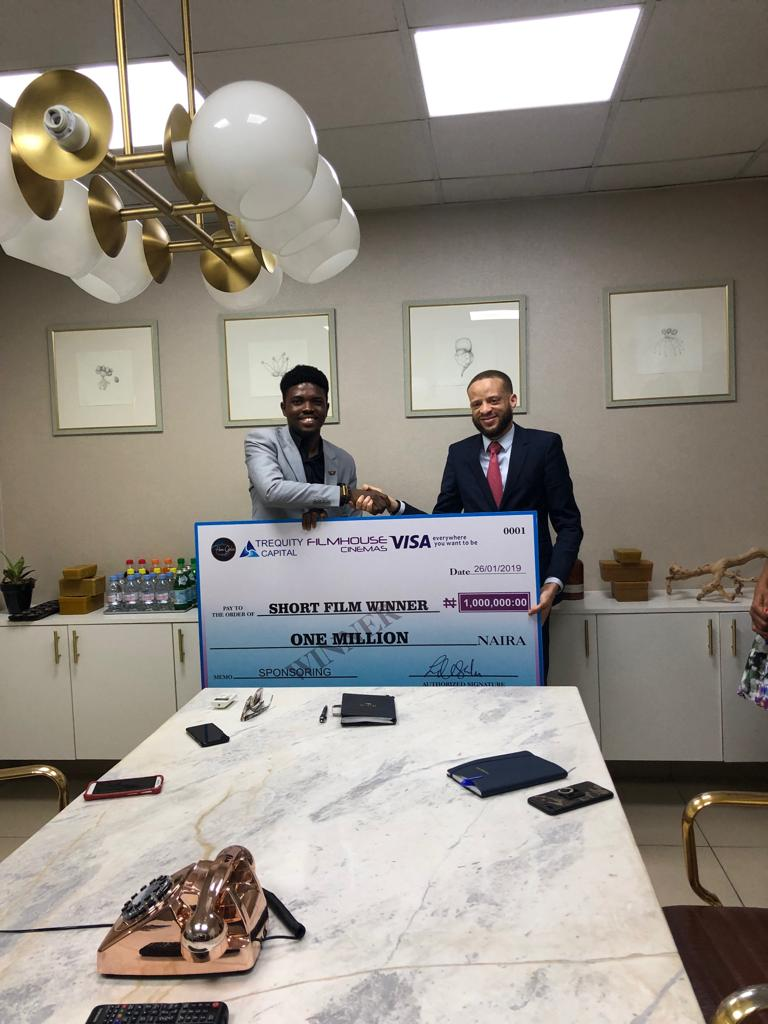 Michael 'AMA Psalmist' Akinrogunde receiving his prize from the Managing Partner of Triequity Capital (Nigeria), Mr. Tosin Ashafa.