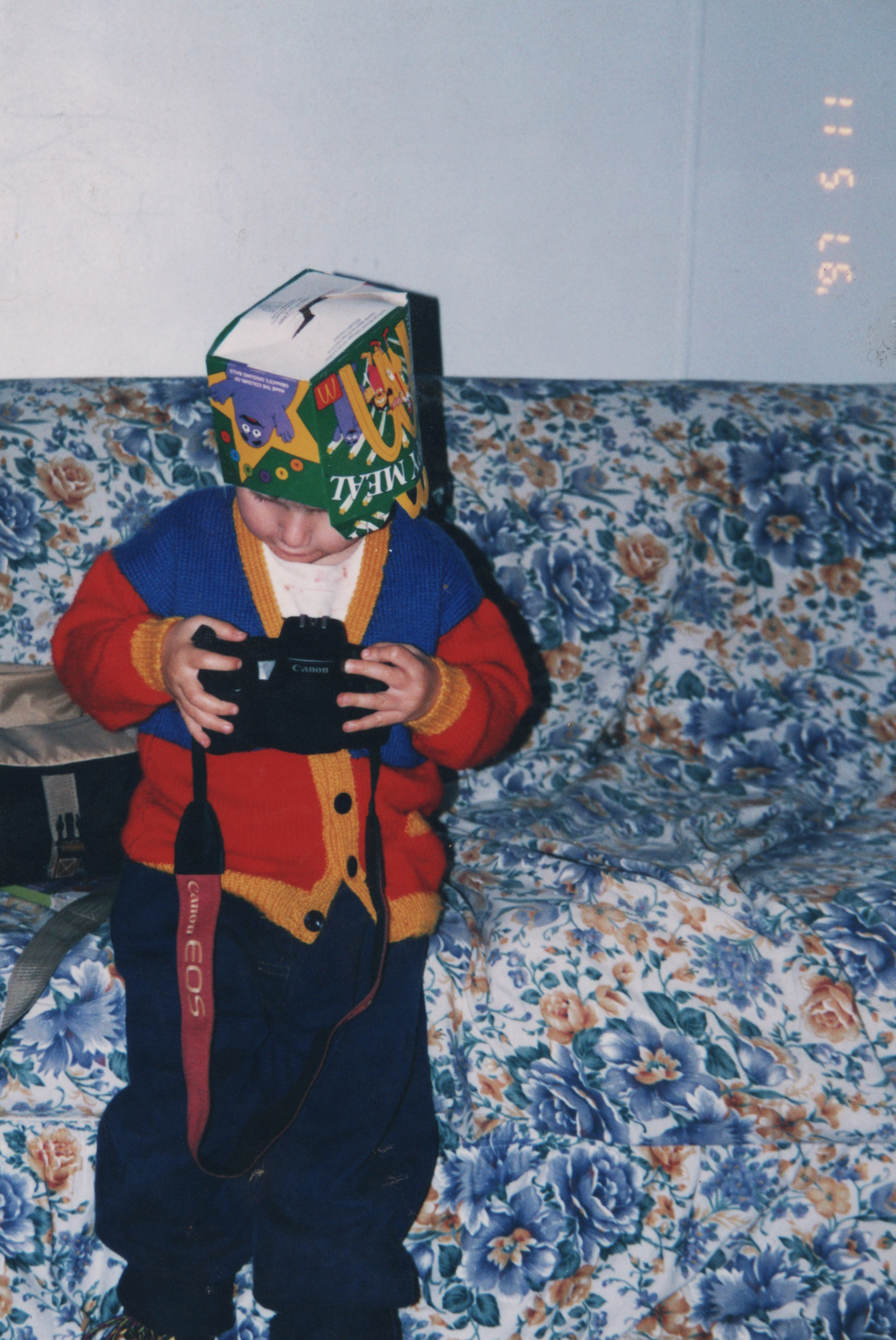 3 Year Old Me, playing with my dads film camera. Adorning a McDonalds Happy Meal Crown 1997