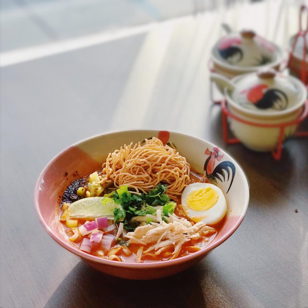 Khao Soi - Northern Thailand's Most Famous Curry DishTopping :Chosen Protein, Boiled Egg, Crispy Wonton Noodles, Red Onions, Pickled Chinese Mustard, Cilantro, Scallion, Celery and Lime.Your Protein Choice :Shredded Chicken,Tofu,Beef, ORCrispy PorkNoodles : Egg Noodles