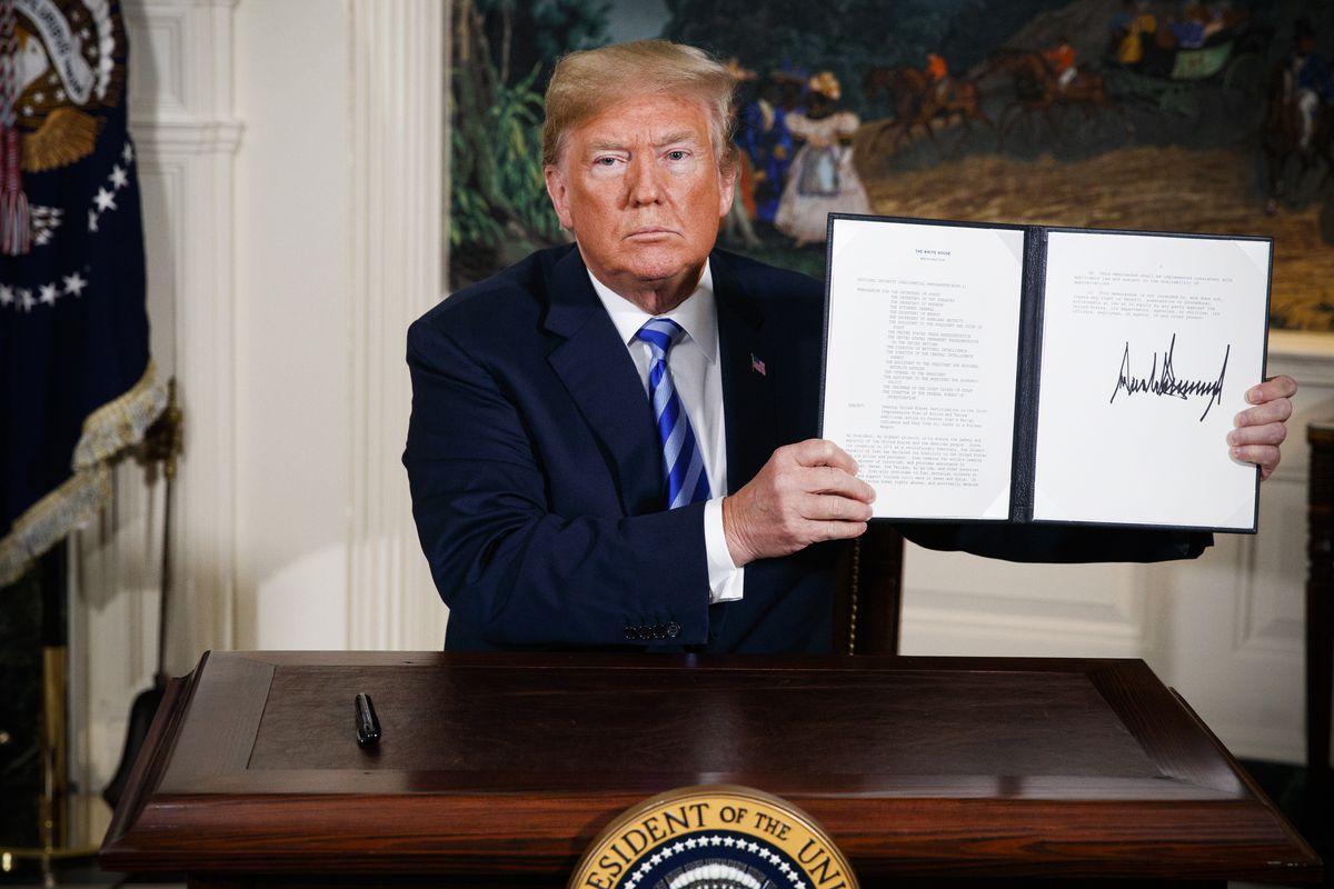 President Trump signing a memorandum reimposing sanction on Iran.