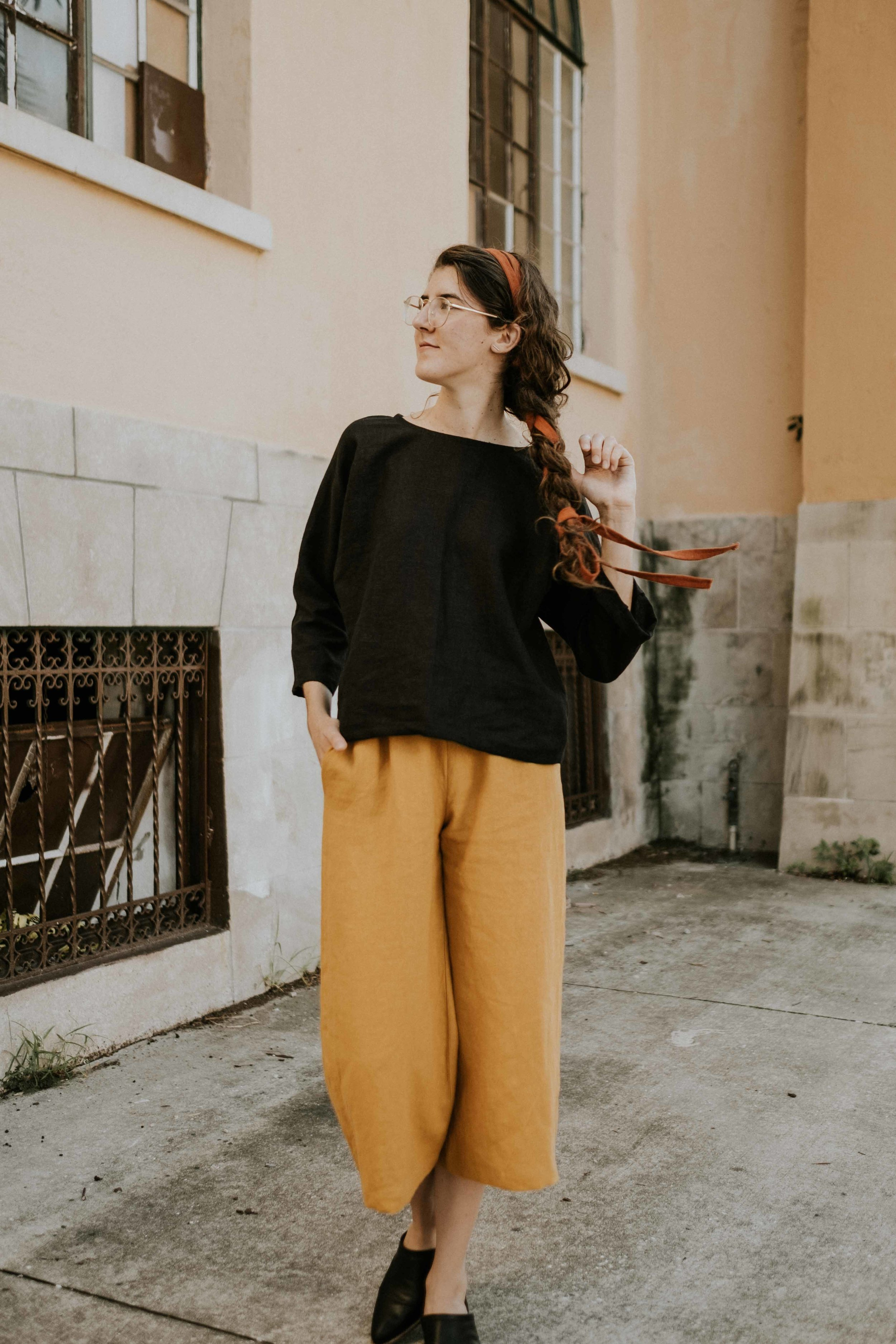 Amanda modeling the Gabriella Three-Quarter Sleeve Top in black linen and the Gloria Wide Leg Pant in golden linen