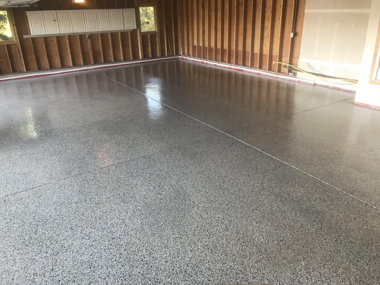 White Granite Flake Mix on this Polyaspartic Garage Floor
