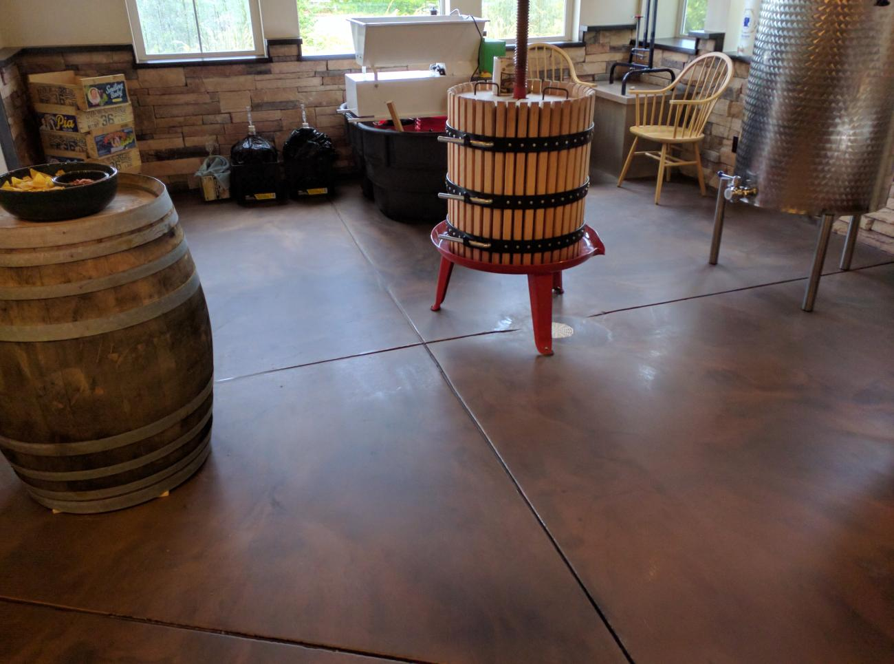 Matte Metallic Epoxy Applied To Concrete Floor in Wine Room Cellar