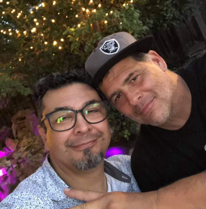 - Here's WHY: I'm wearing the Raiders hat and my partner Javier is on the left.We've been friends since 1992 and partners since 2005.Javier grew up in Chile.This is not written for anyone to pat me on the back…(Honey I've been out a long time and I'm not going in anytime soon - gay humor).I really wanted to paint a picture of what it is like to grow up gay in small-town South Dakota. Seems like there can be some real conversations on how to help a segment of our population that struggles with 'their' reality.The suicide stats are real…How can WE do BETTER?