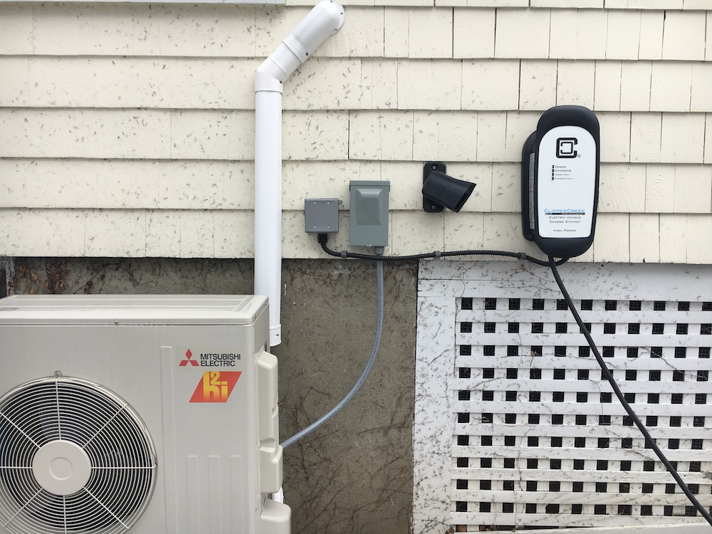 A heat pump and electric car charger installed on a Burlington home are powered by rooftop solar panels Photo: Julie Campoli