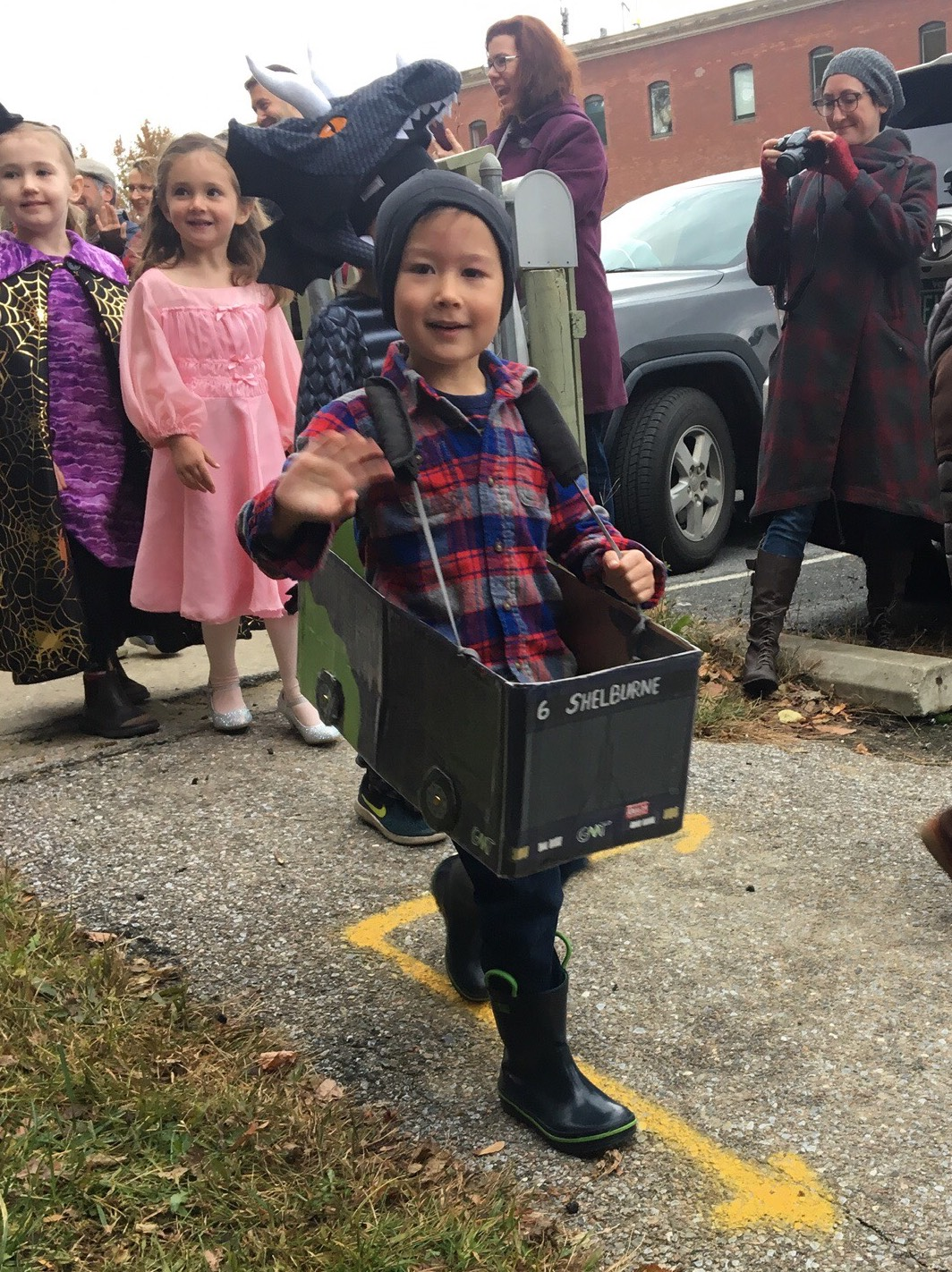 A young bus enthusiast showing off his No. 6 bus Halloween costume
