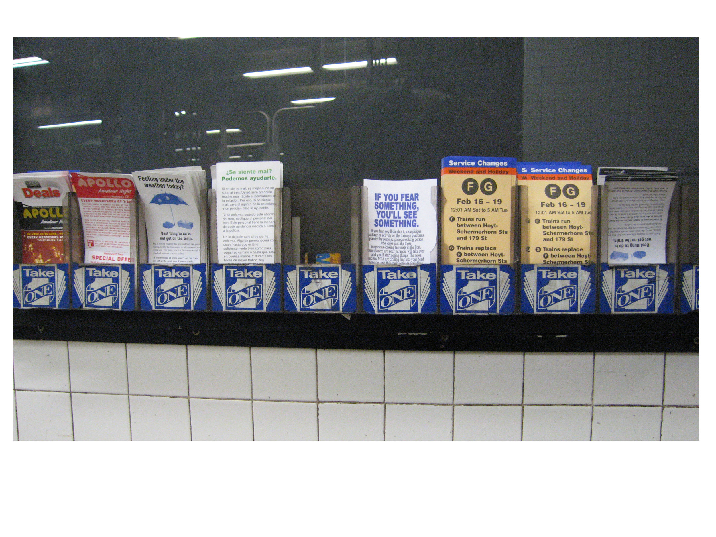 """Flyers in the """"Take One"""" slots on a subway platform, NYC 2004,"""
