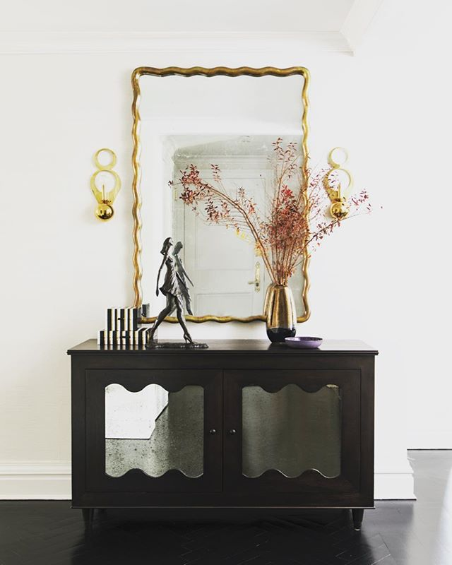 Inspired by my most favorite, Royere, we designed this mirrored cabinet to reflect light into a once dark foyer of a New York apartment. I loved this project and it's transformation. 📷: @laurejoliet - - - - #caitlinmoraninteriors #beforeandafter #jeanroyere #newyorkcity #interiordesign