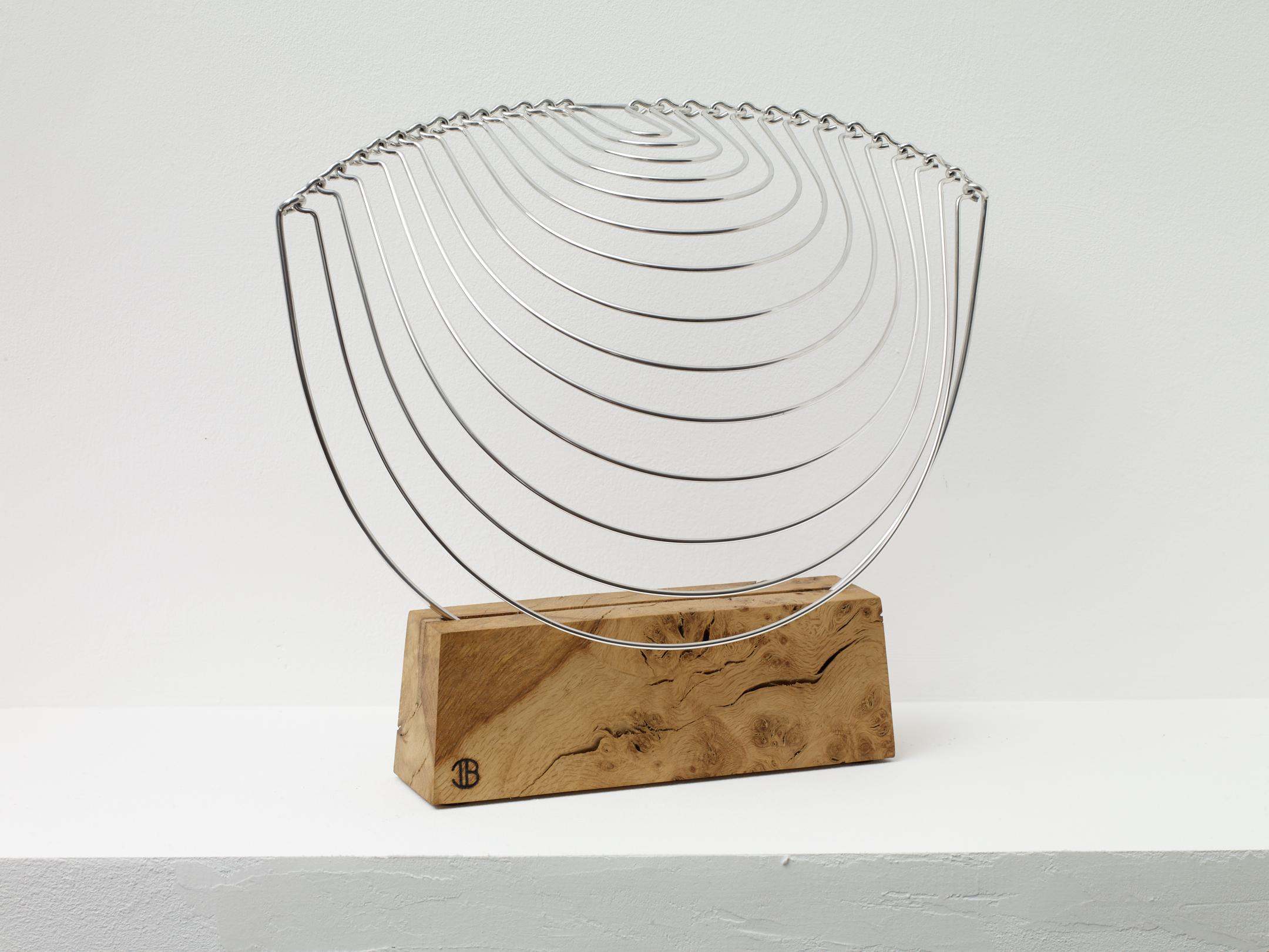 Ivan Black  Loop Wave,  2018 Aluminium and burr oak 30 x 27 cm Edition 2 of 10