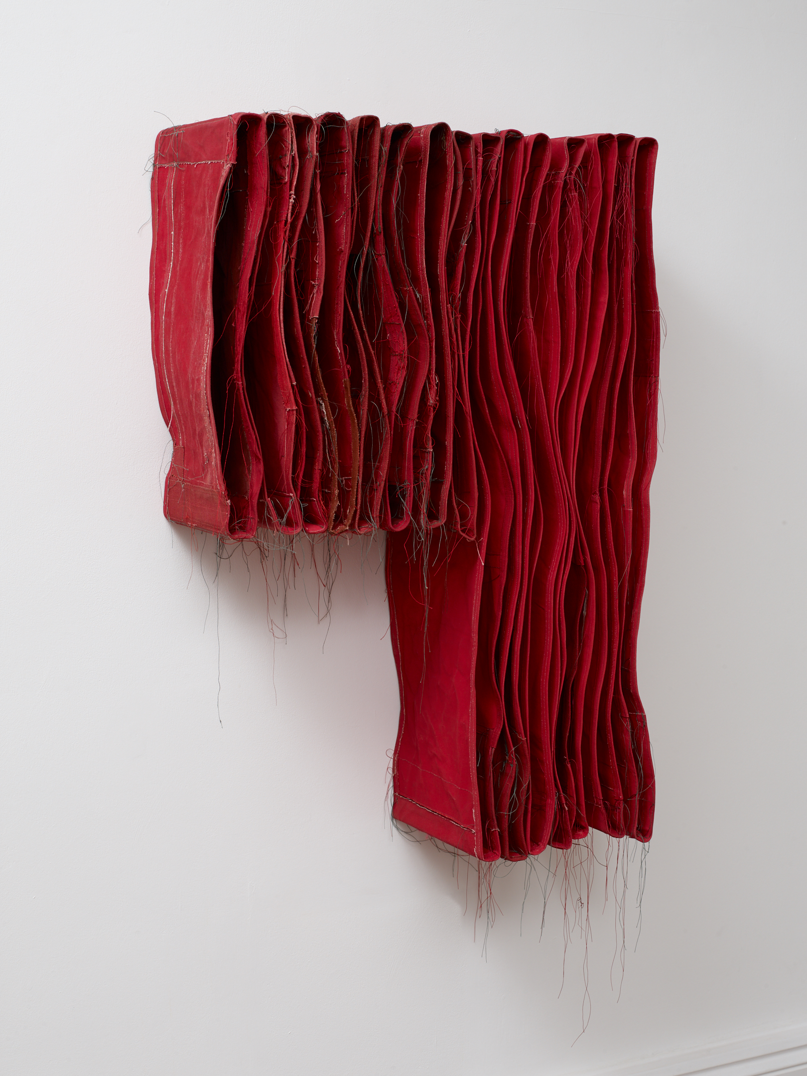 Simon Callery  Punctured Red Wallspine,  2017 Canvas, distemper, thread, pencil and metal brackets 92 x 64 x 26 cm