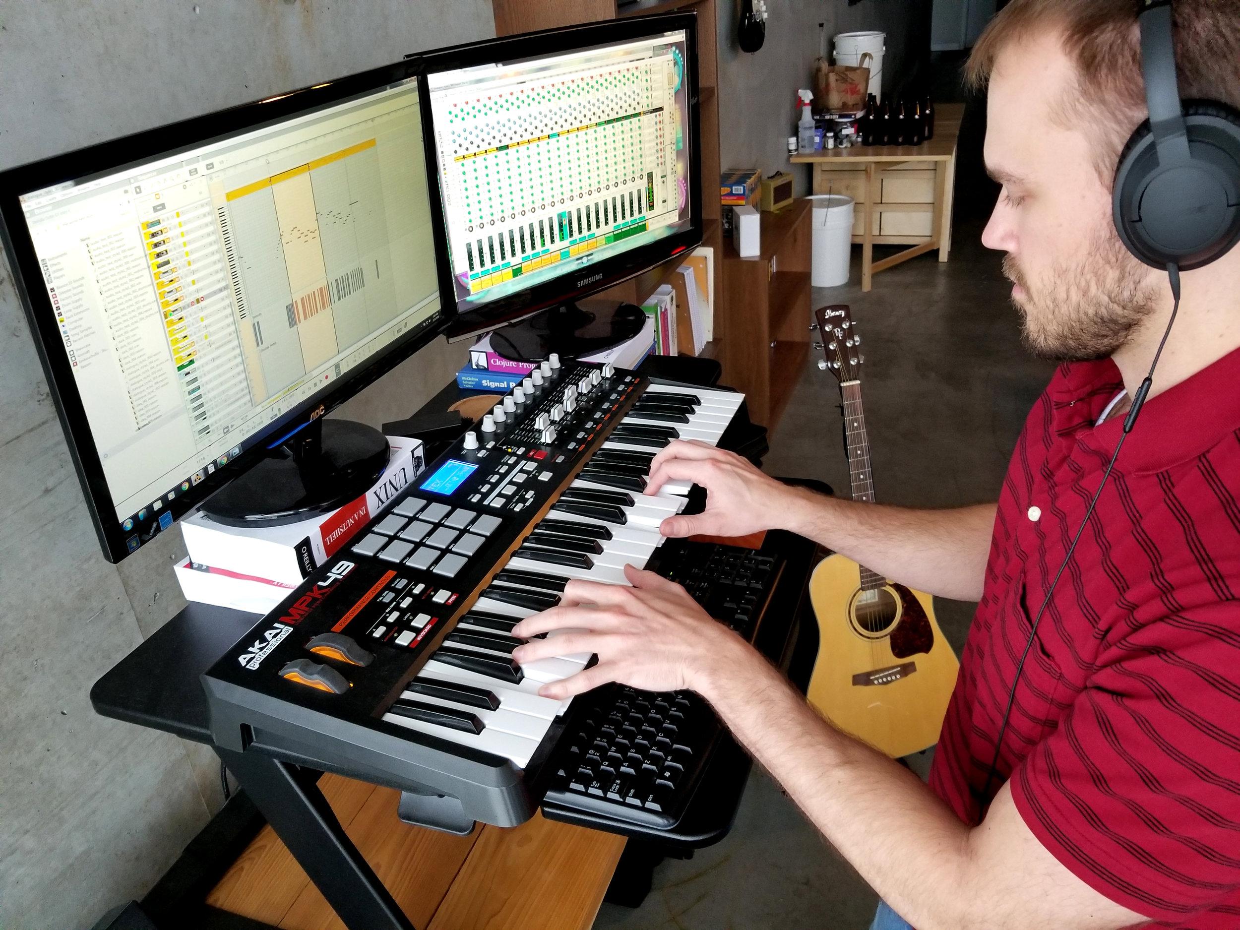Andrew, composing in his studio.
