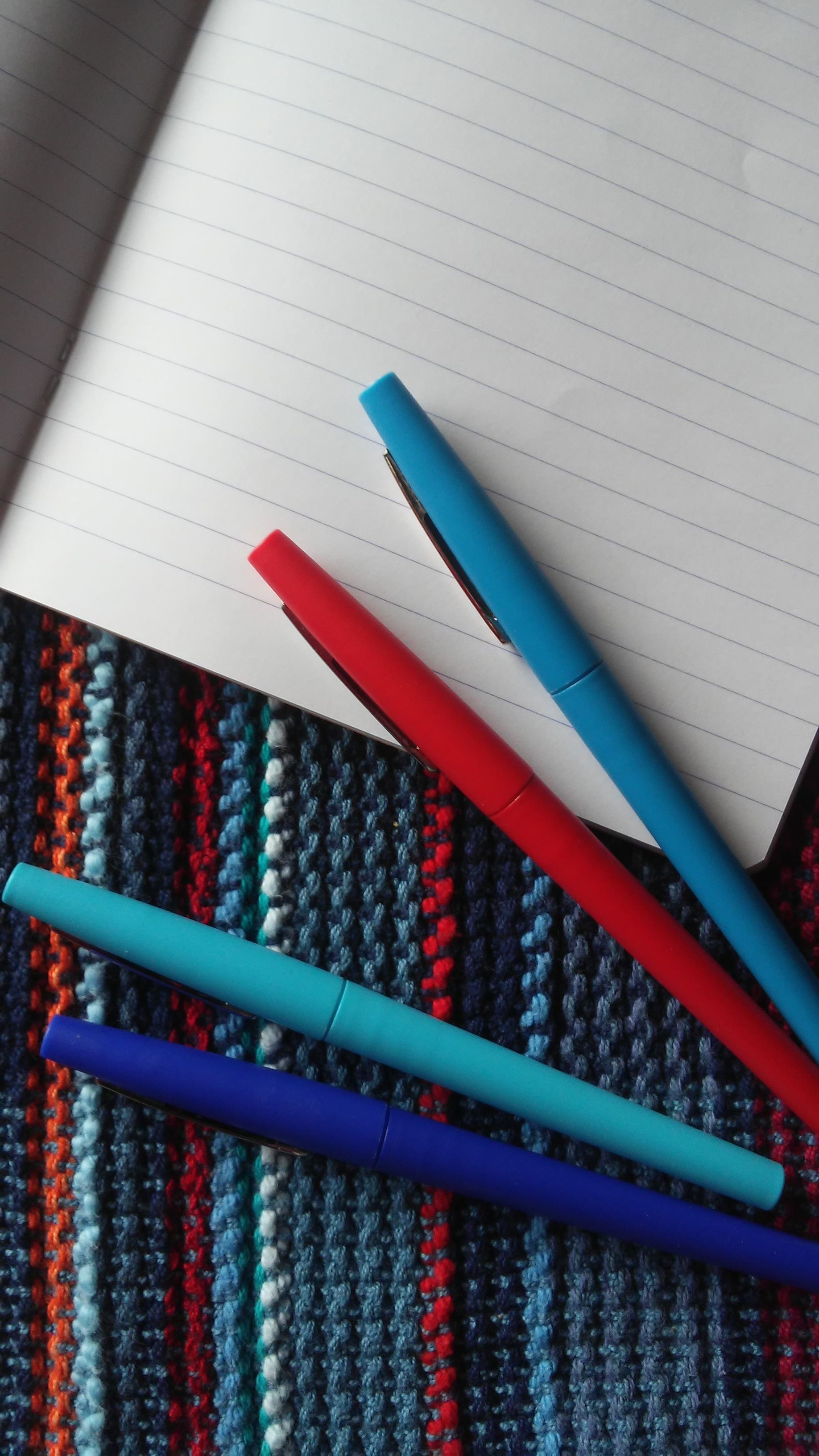 interwoven editing pens and notebook vertical.jpg