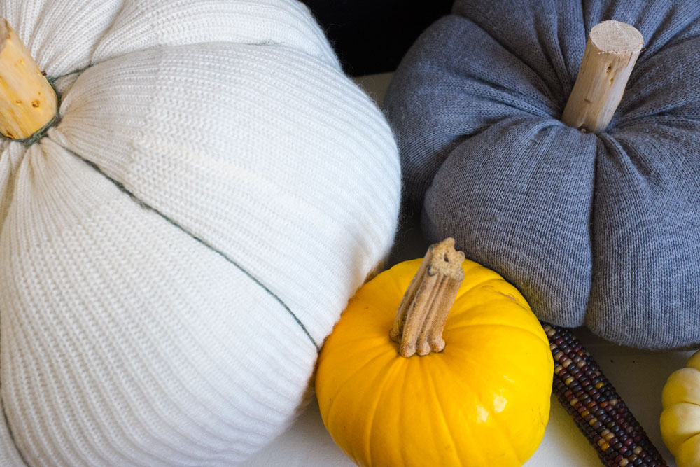 STEP 5 (optional): Create indentations around the pumpkin by either sewing long stitches through the top and bottom then pulling to form the indent. For the white pumpkin, I opted to simply wrap thin twine around the pumpkin because it was just too big to sew through.