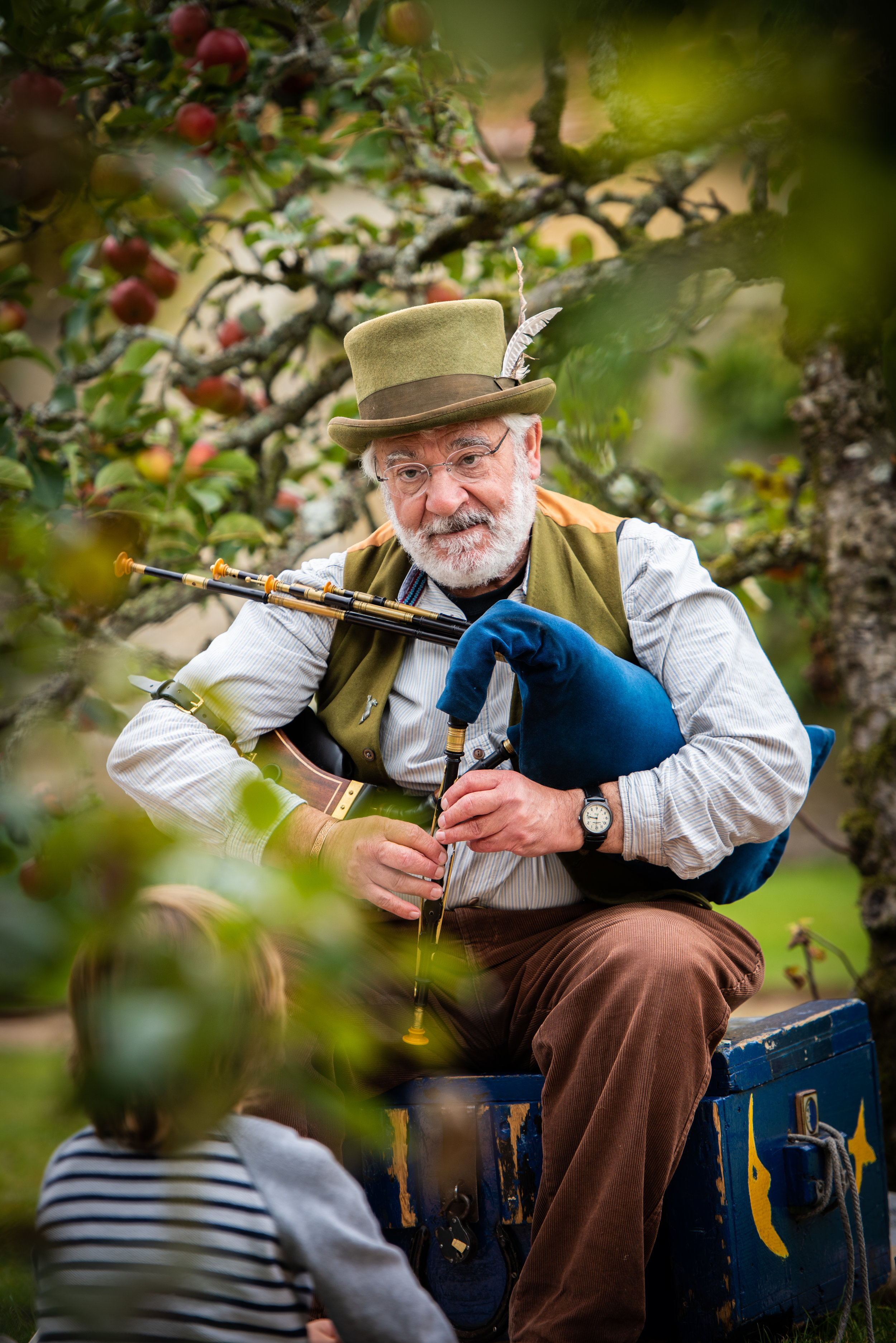 The writer and Storyteller Michael O'Leary in the orchard at Houghton Lodge Gardens near Stockbridge in Hampshire