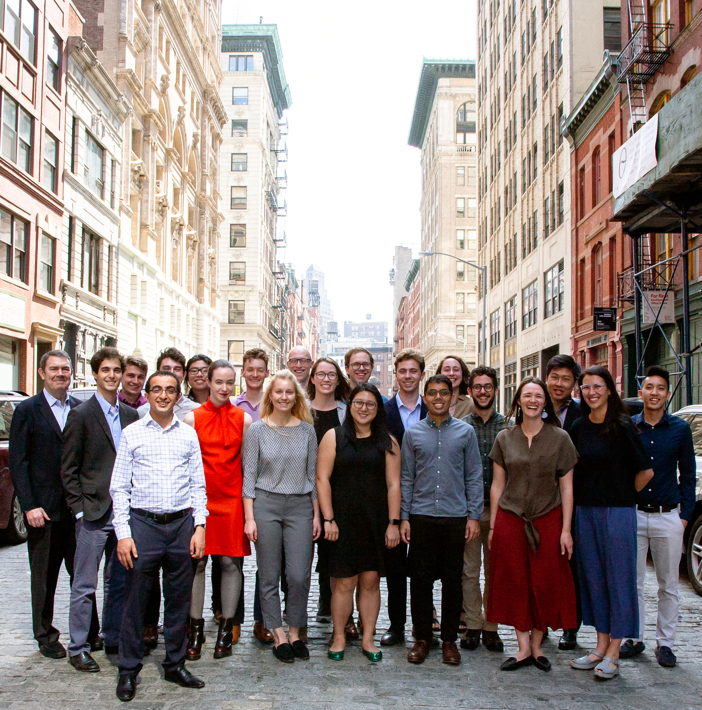 Locus employees standing in Manhattan street.