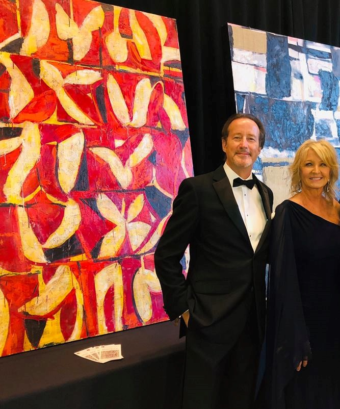 "With my wife, Cindi, at the Ballet Austin Fete Gala silent auction. Showcasing my pieces ""Matador"" and ""Old School""."