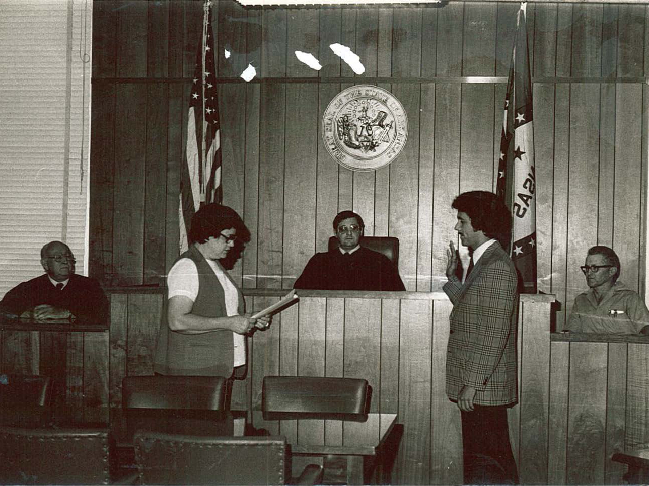 """^ Chuck's mother, Essie Mae Black, (who was the Montgomery County Circuit Clerk) swearing Chuck in to practice law in September 1980. In the center back of the photo is Circuit Judge Gayle Ford, to the left of the Judge is Chuck's father, William """"Bill"""" Black, to Judge Ford's right is Municipal Judge Halbarnes."""
