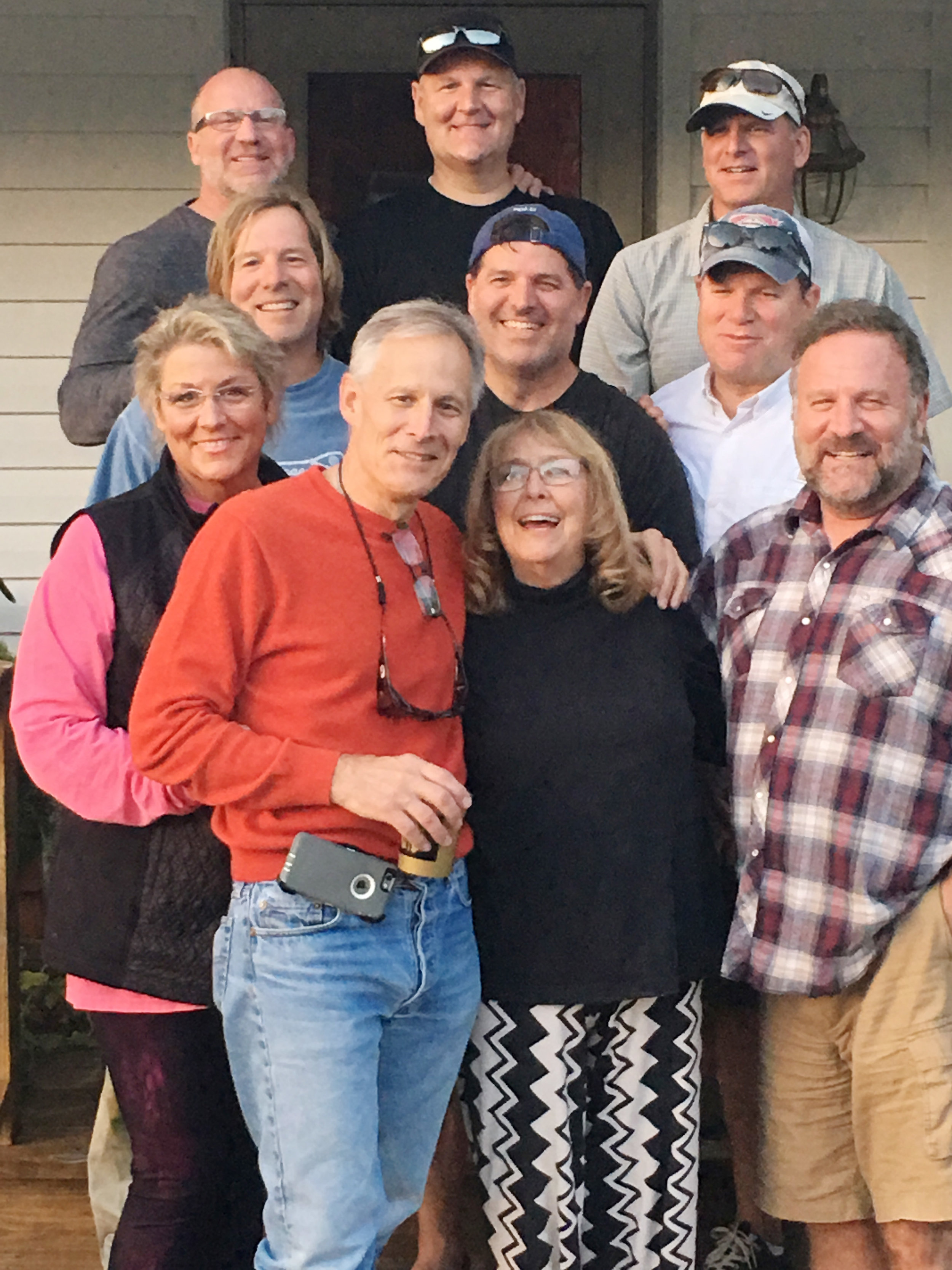 ^ Mary Ellen (left) celebrated Thanksgiving 2016 with her mother and eight brothers. With her are: (first row) oldest brother, Mike; mother, Donna; and second to the oldest brother, Mark.  (second row) brothers John, Chris, and Tom; and (back row) brothers David, Matt, and Pat