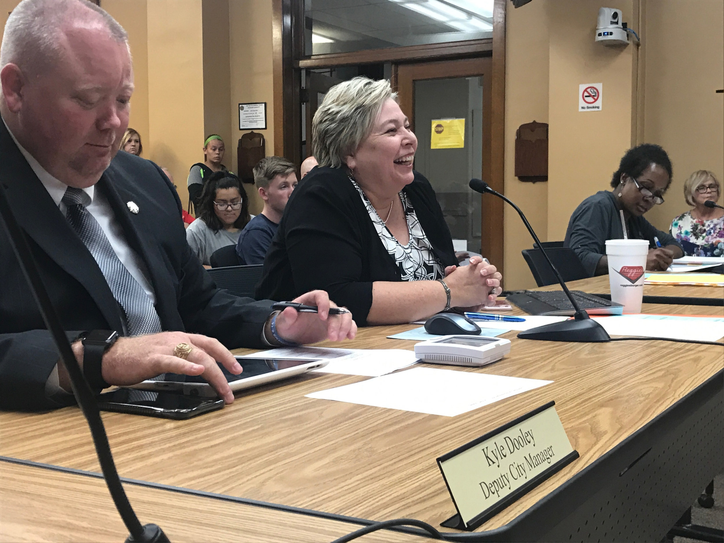 ^ Shirley shares a smile during a City Council meeting the moment she was named the city's first ever female city manager.