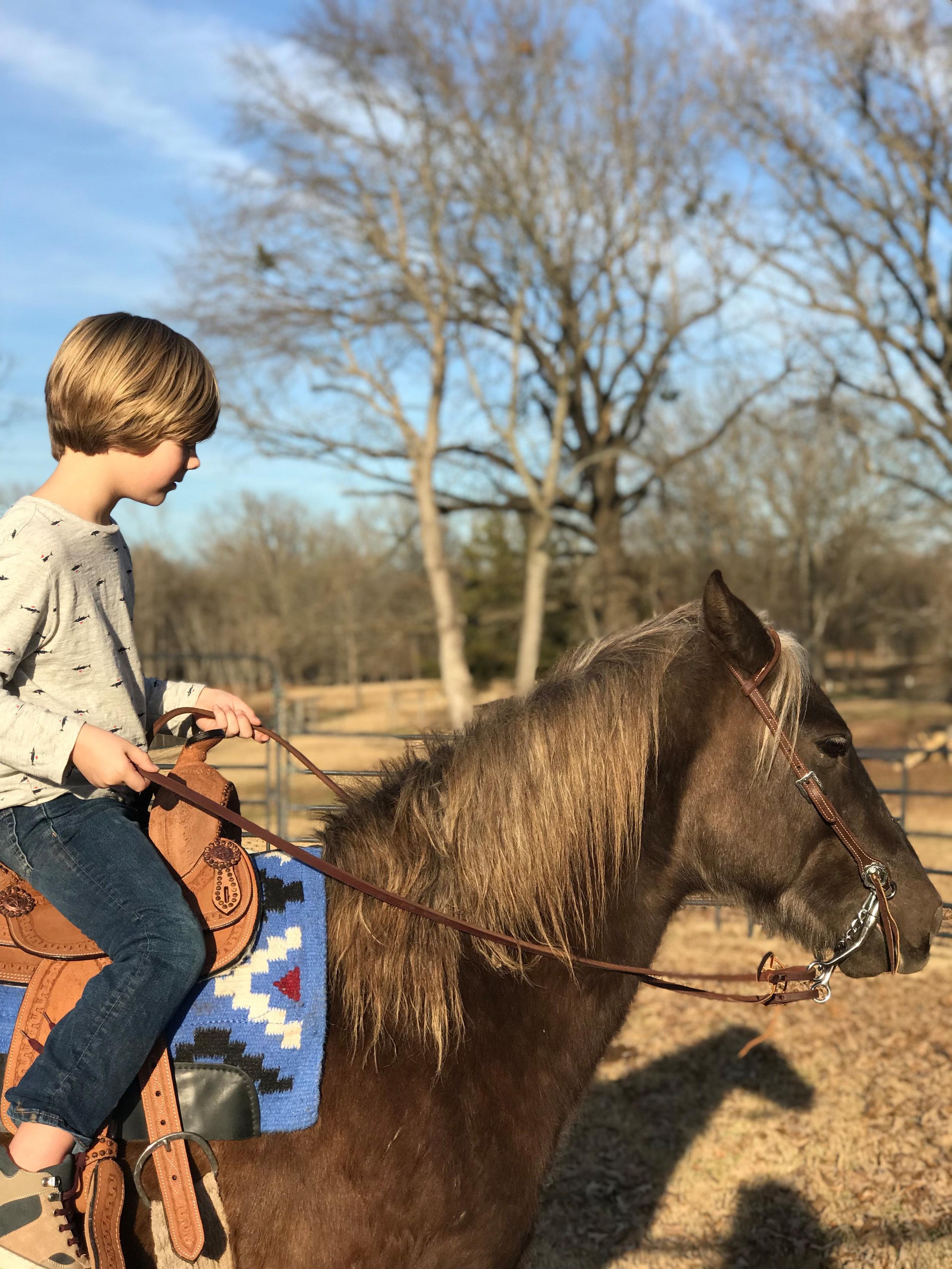 """^Judah enjoys riding his horse, """"Pistol,"""" after school."""