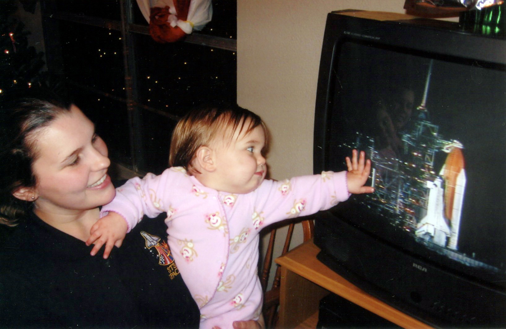 ^ During December 2006, Marie and Elliot watched the night launch of STS-116 Discovery to the ISS from their first home in Webster, Texas. This was the first shuttle mission Marie took part in while working for SpaceHab.