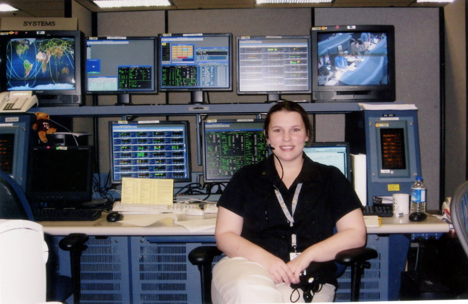 ^ While working for SpaceHab, Marie worked in the Payload Operations Control Center in Mission Control in Houston, Texas.