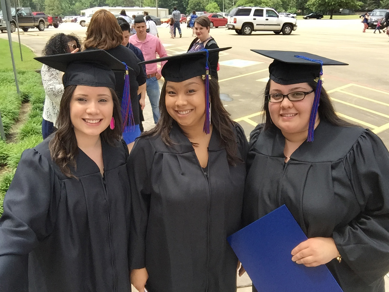 ^ Texas A&M-Texarkana graduates Jessica, friend Nicole Cruz, and Marisol on May 16, 2015. Both Jessica and Marisol graduated with bachelor's degrees in Business Administration.