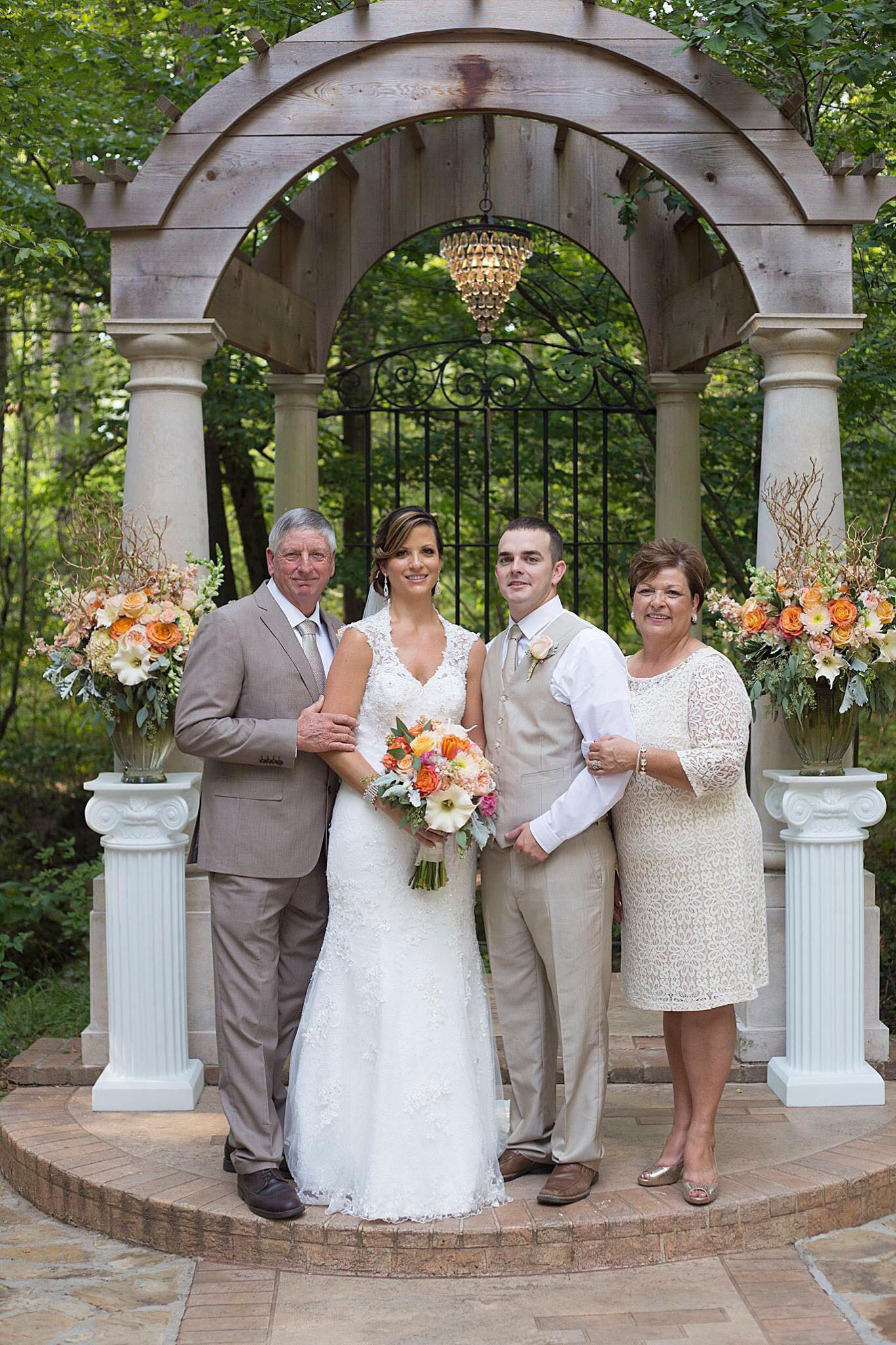 ^On their wedding day, August 29, 2015, Bubba and Jana took a minute to have this photo taken with her parents, Jimmy and Linda Parker. (Photo by Megan Garrison)