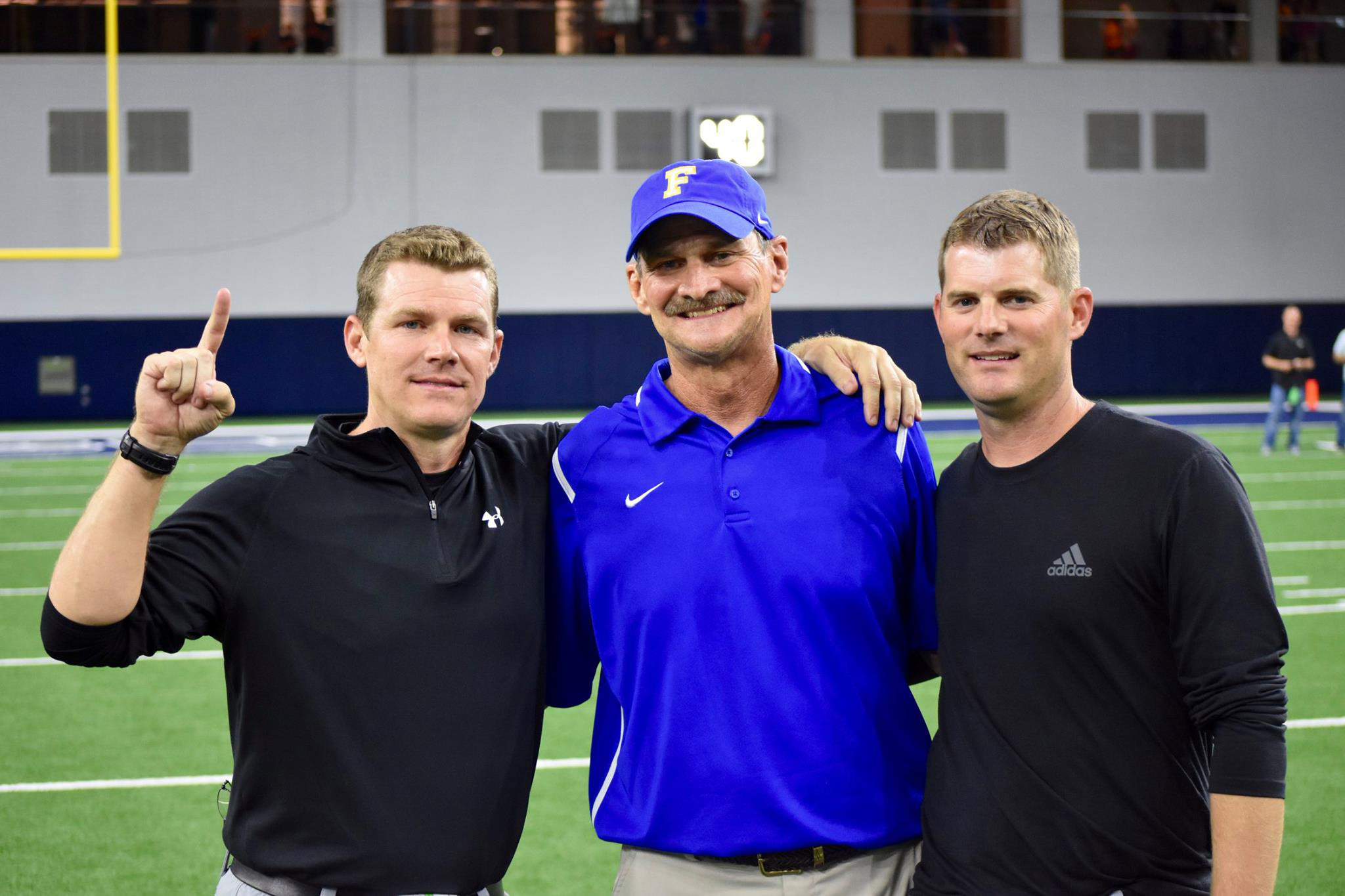 ^ Josh with his father, Vance, and brother, Justin, during a game against Frisco at the Dallas Cowboys' Star Stadium. Josh was coached by his father, and has coached with both his father and his brother.