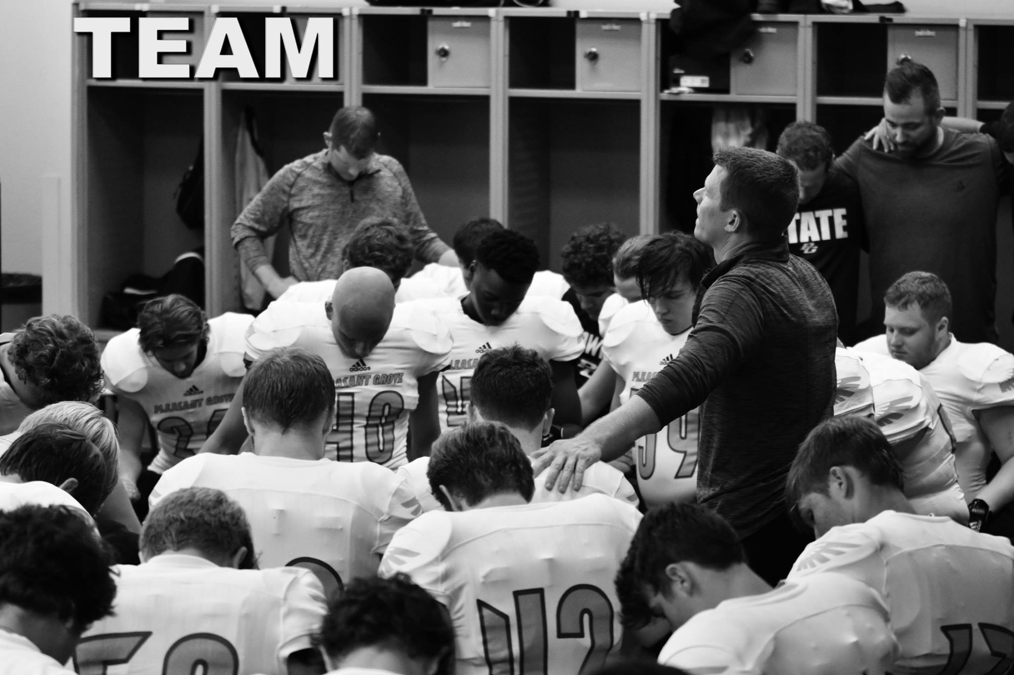 ^Josh and members of the Pleasant Grove Hawk team during a pre-game prayer.
