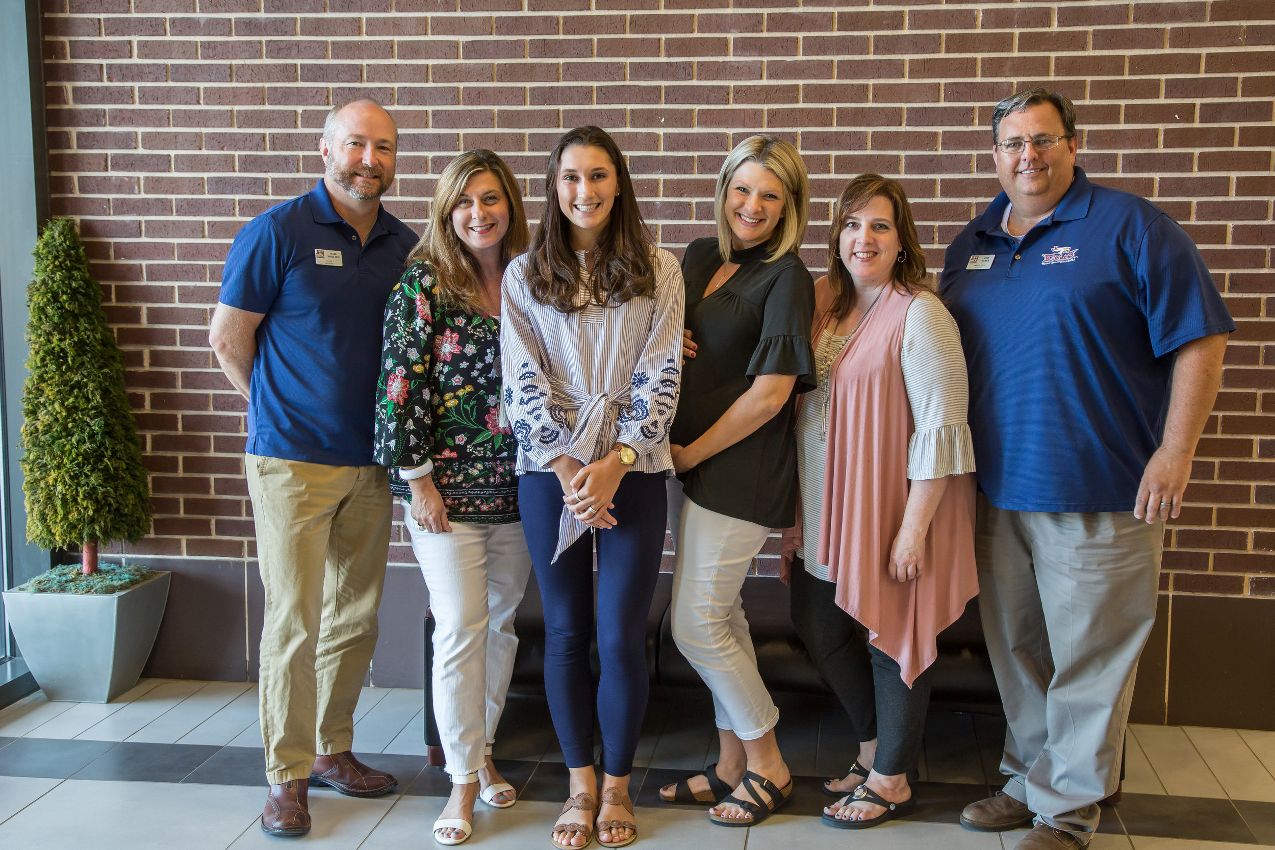 ^ Rebekah (third from left) with some of her coworkers in the University Advancement department at TAMU-T. They include: Mark Missildine, Stacy Glover, Lindsey Clark, Shannon Gustafson and John Bunch. (Not pictured are: LeAnne Wright and Courtney Boeckmann.)