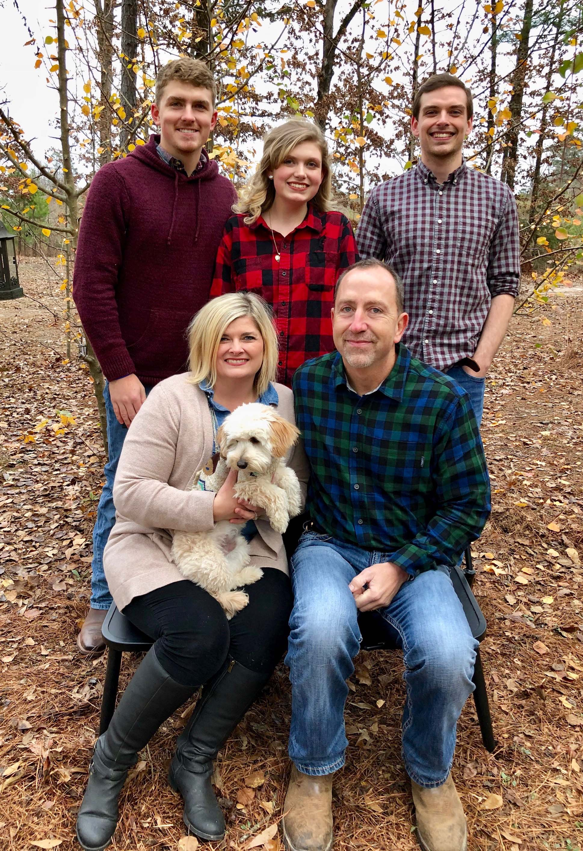 """Last Christmas, Kim and Scott celebrated the holiday with their children, Micah, Olivia, and Aaron, and their puppy, """"Charlie."""""""