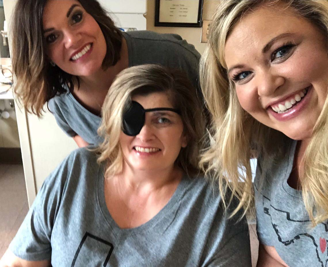 Kim (center) with Tiffannee Watson and Lindsey Eaves (two of the four sisters), during a Girls' Day at Encompass this past August. Kim wore the patch to help strengthen her eye function.