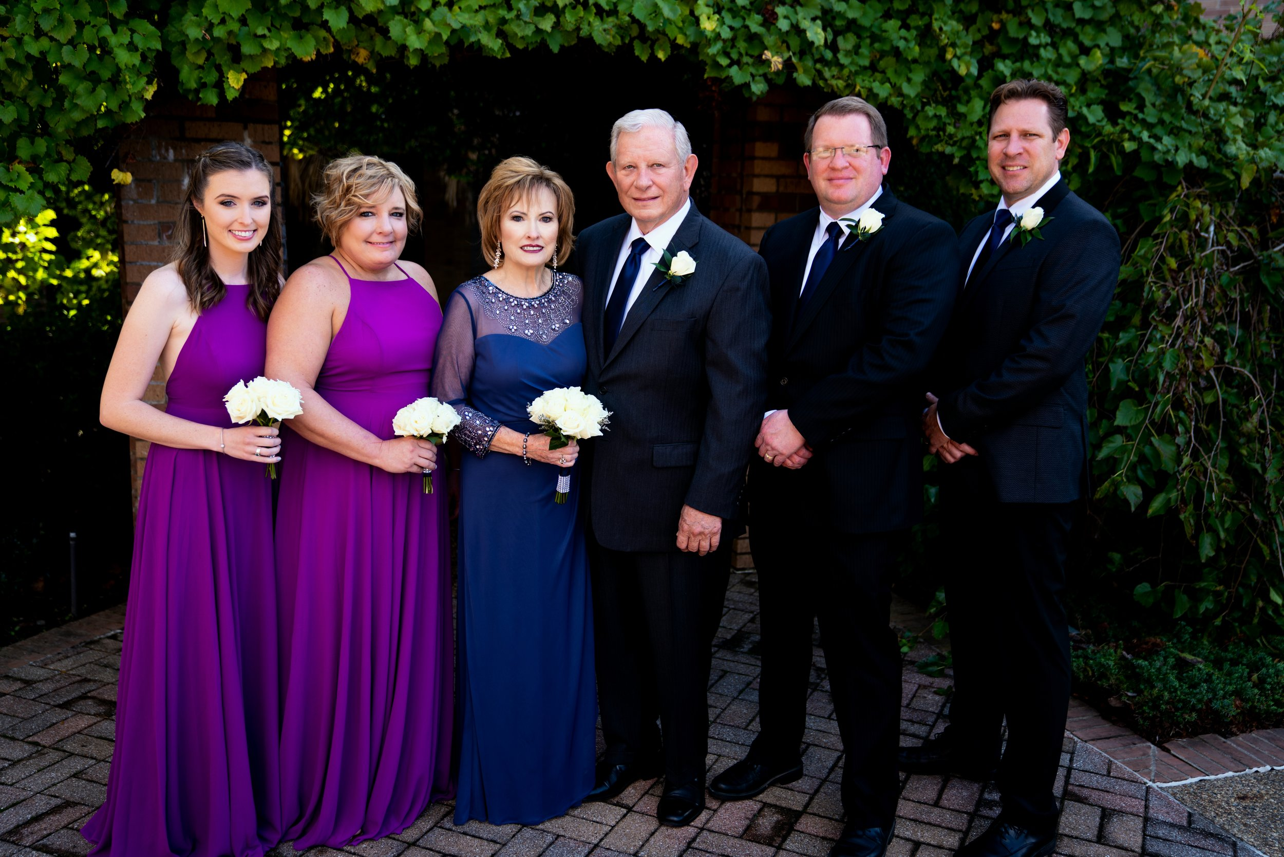Vee and Ron on their wedding day, October 20, 2018, with Bentleigh Barnett (Vee's granddaughter), Leigh Barnett (Vee's daughter), John Collins (Ron's son), and Aaron Collins (Ron's son). (Photo by Bryan Jefferies – Fresh Focus Films)