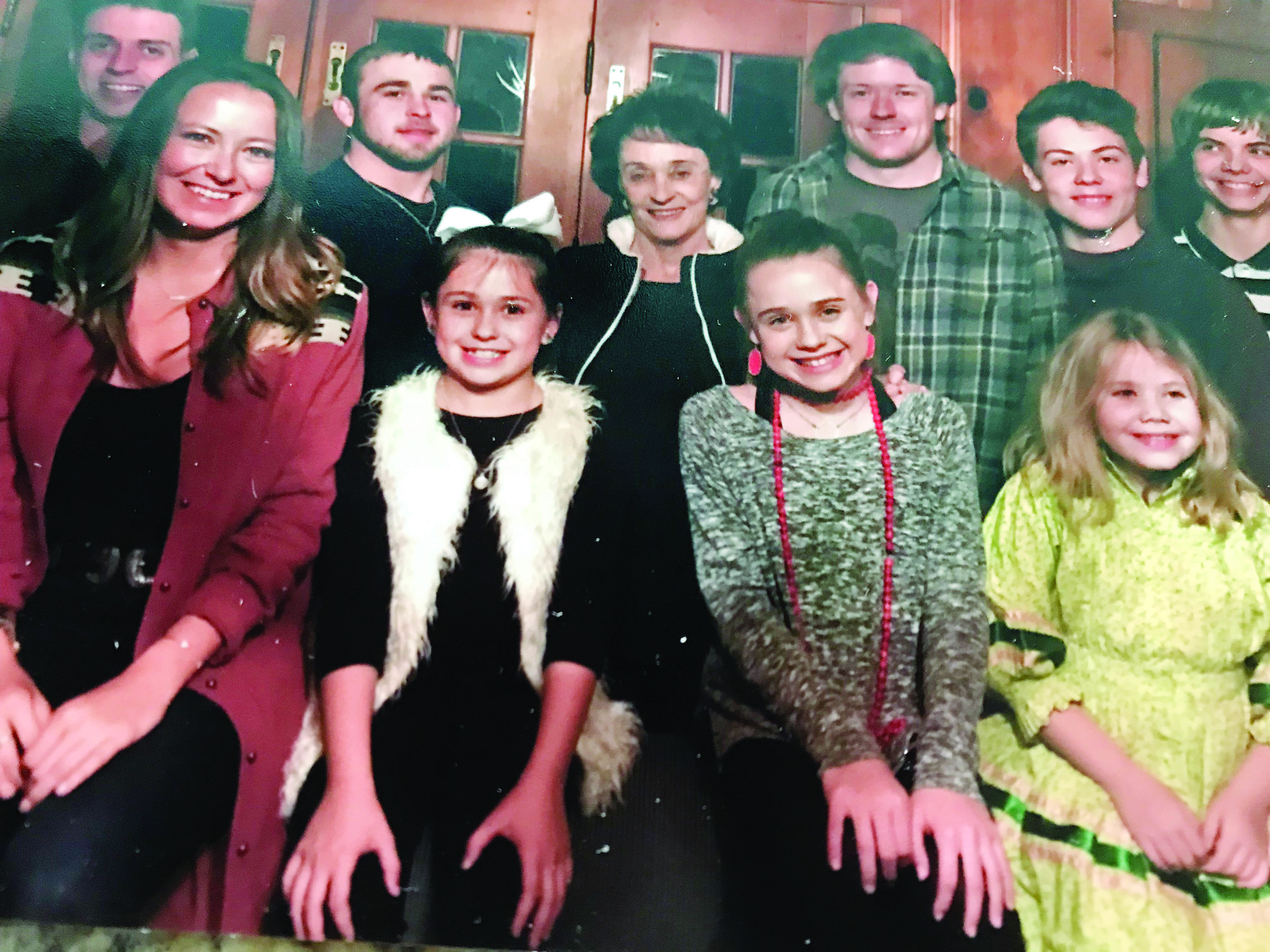 Betty Jo surrounded by her nine grandchildren on Thanksgiving 2017. With her are: (front row) Allie, Francie, Helen Clark and Clementine; (back row) Edward, Luker, Thomas, Arthur and Tristan.