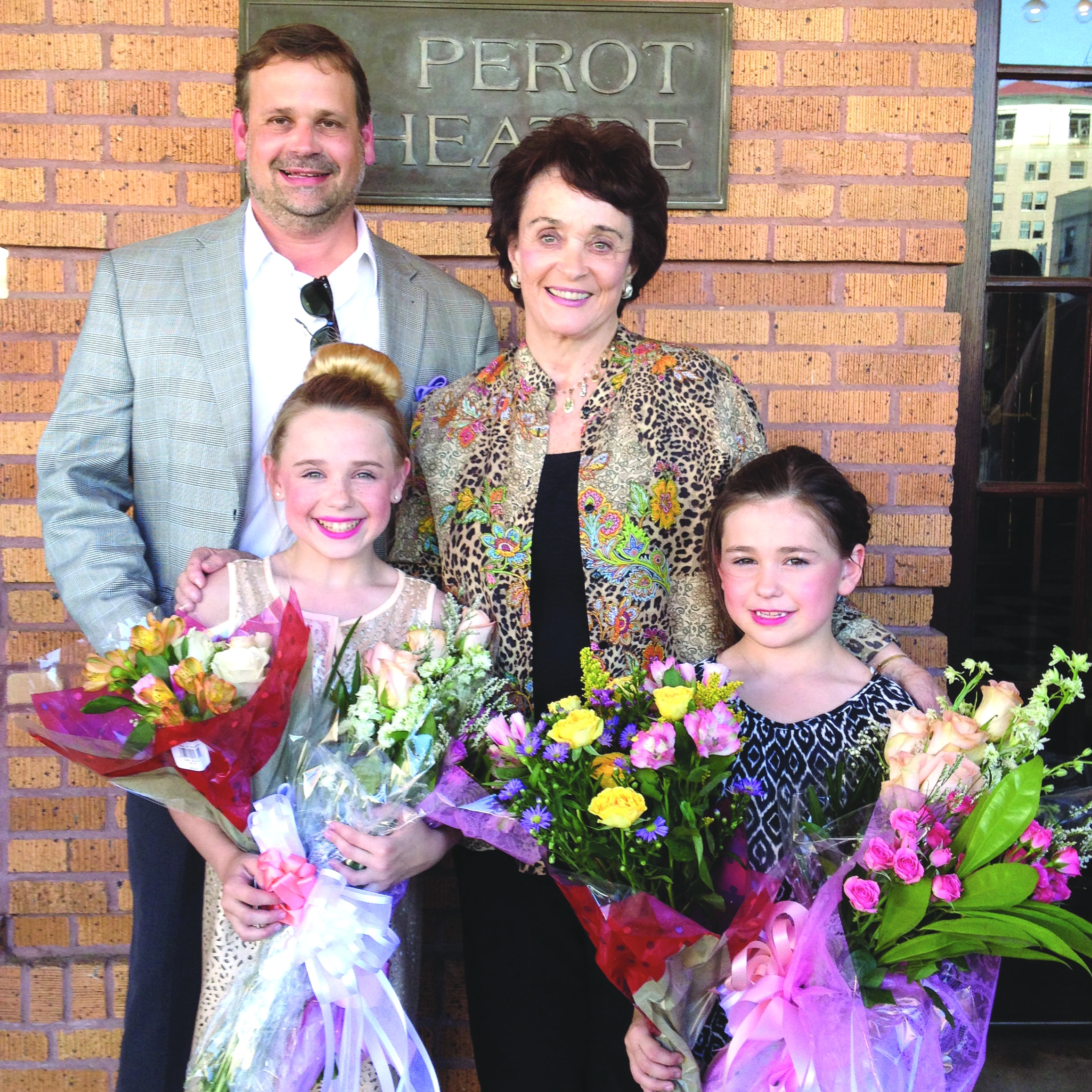 After her granddaughters' dance recital last year, Betty Jo and son, John, take time to congratulate her granddaughters, Helen Clark and Francie.
