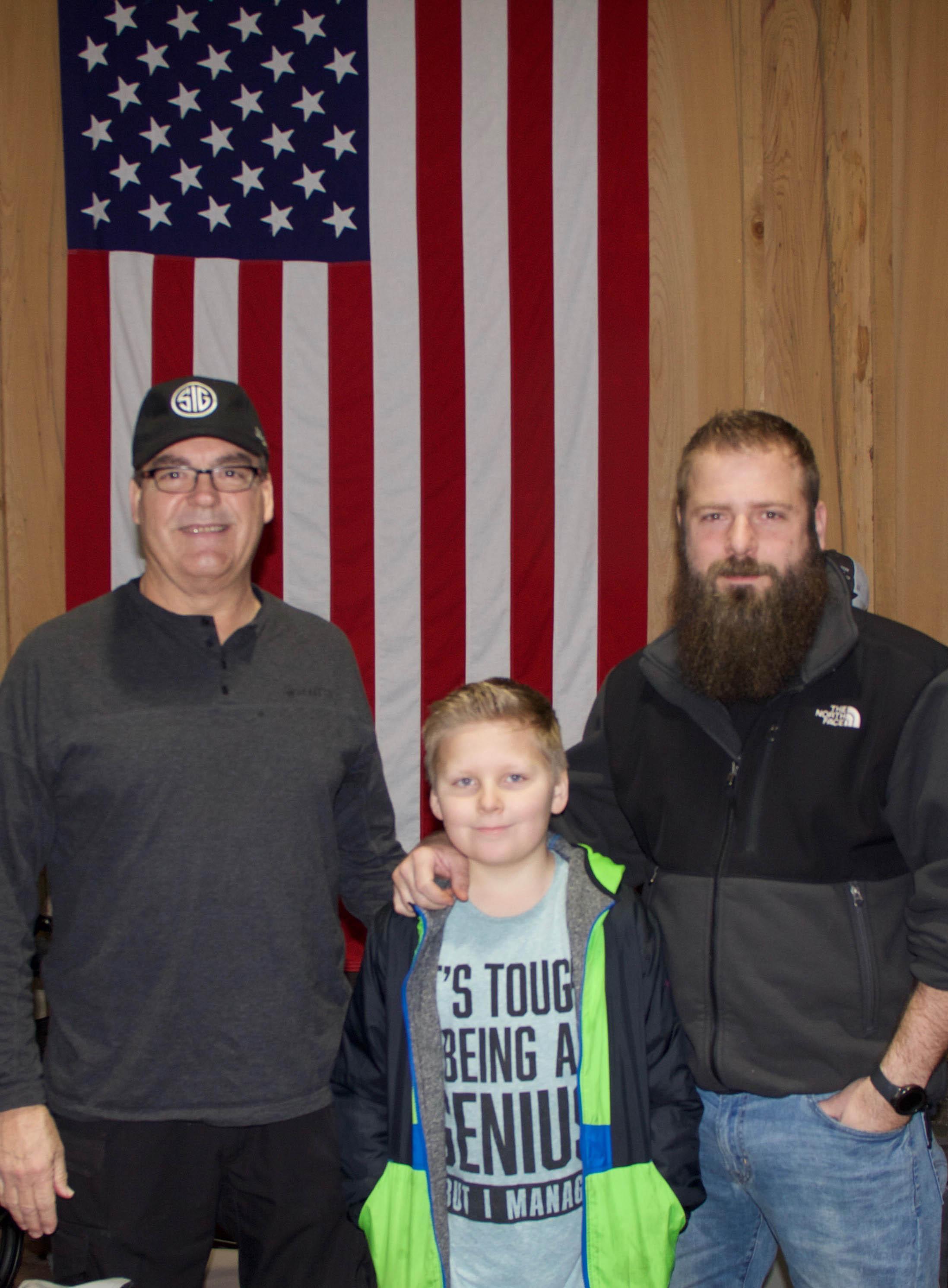 Stan Garrett, Ethan Maynard and Cody Maynard of Garrett's Outdoor Supplies