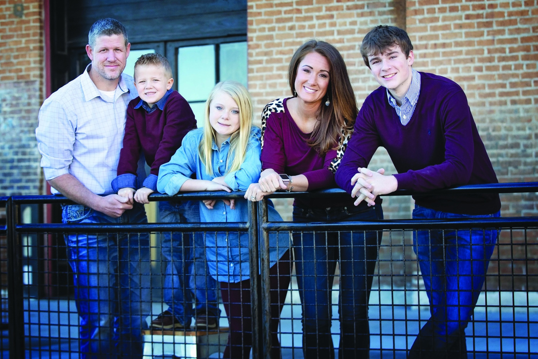 Jill's reasons for becoming interested in pursuing healthier options are her husband, Kevin; bonus son, Hosston; daughter, Alexis; and son, Drew. Through the home remedies that Rowe Casa offers, the Rowes have become a healthier family as a whole. (Photo by Erin Treadway Photography)