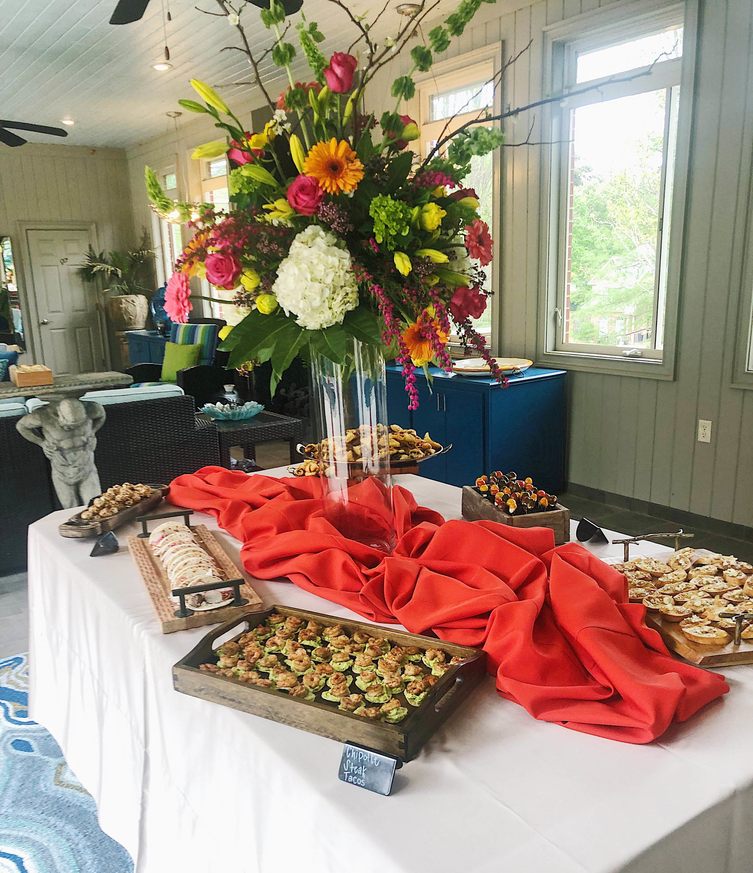 Caprese bites, mini shrimp guacamole tostadas, cream cheese pecan olives, and chipotle steak tacos were the menu items during an event Marjorie catered at Sonja Hubbard's home.