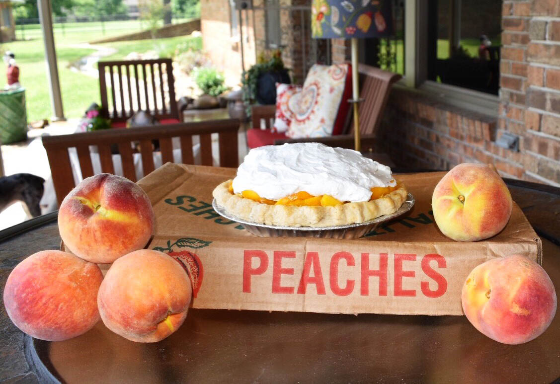 Peach pie is a Marjorie Slimer specialty. She began making these pies with her father when she was little, and now sells them as fast as she makes them.