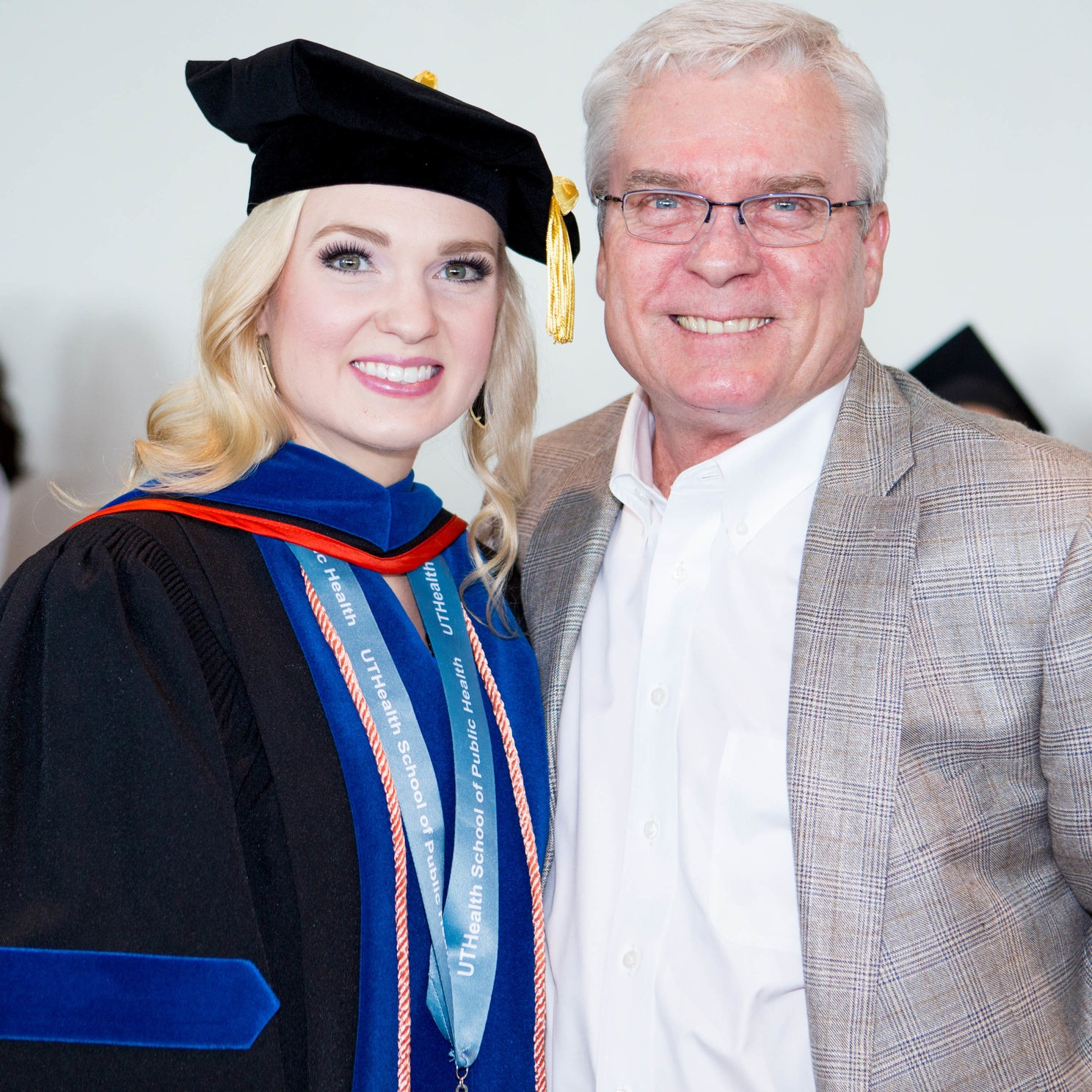 Hadley with her father, Dennis Smith, during her college commencement this past May. (Photo by Savannah Stevens Jarrett)